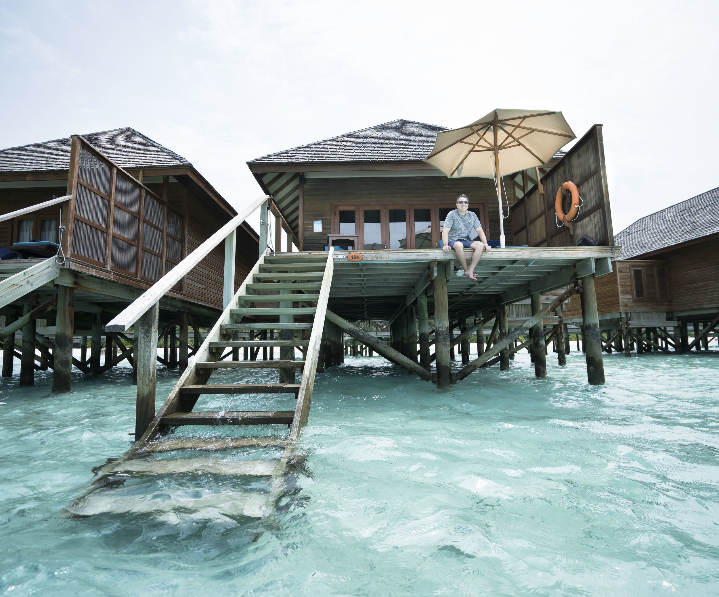 One very happy guy. With a very few short steps you're in the reef. You could also just sit on the deck with a glass of wine and watch the dolphins cruise by... Paradise...