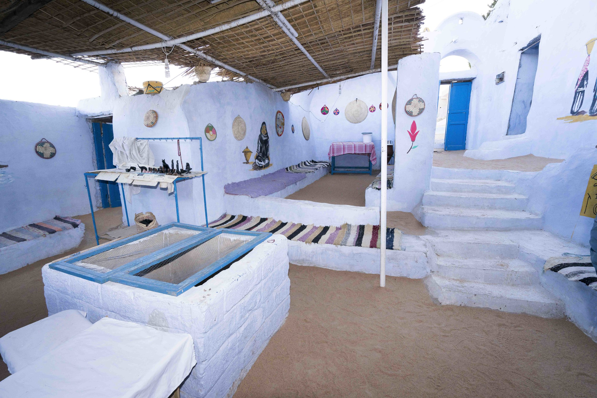 Nubian living room, note the sand floors and the structure in the foreground with the screens on the top