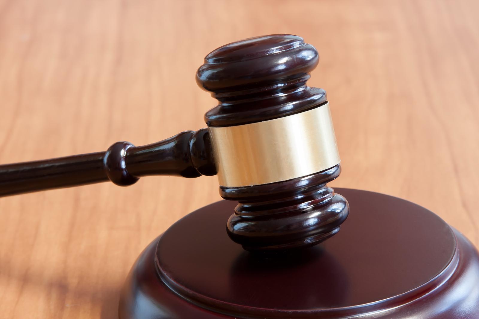bigstock-Judicial-Hammer-On-A-Wooden-T-119911805.jpg
