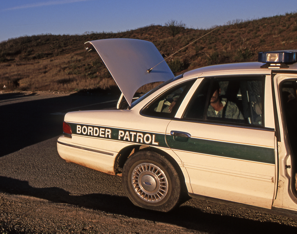 bigstock-Border-Patrol-Car-With-Suspect-1518588.jpg