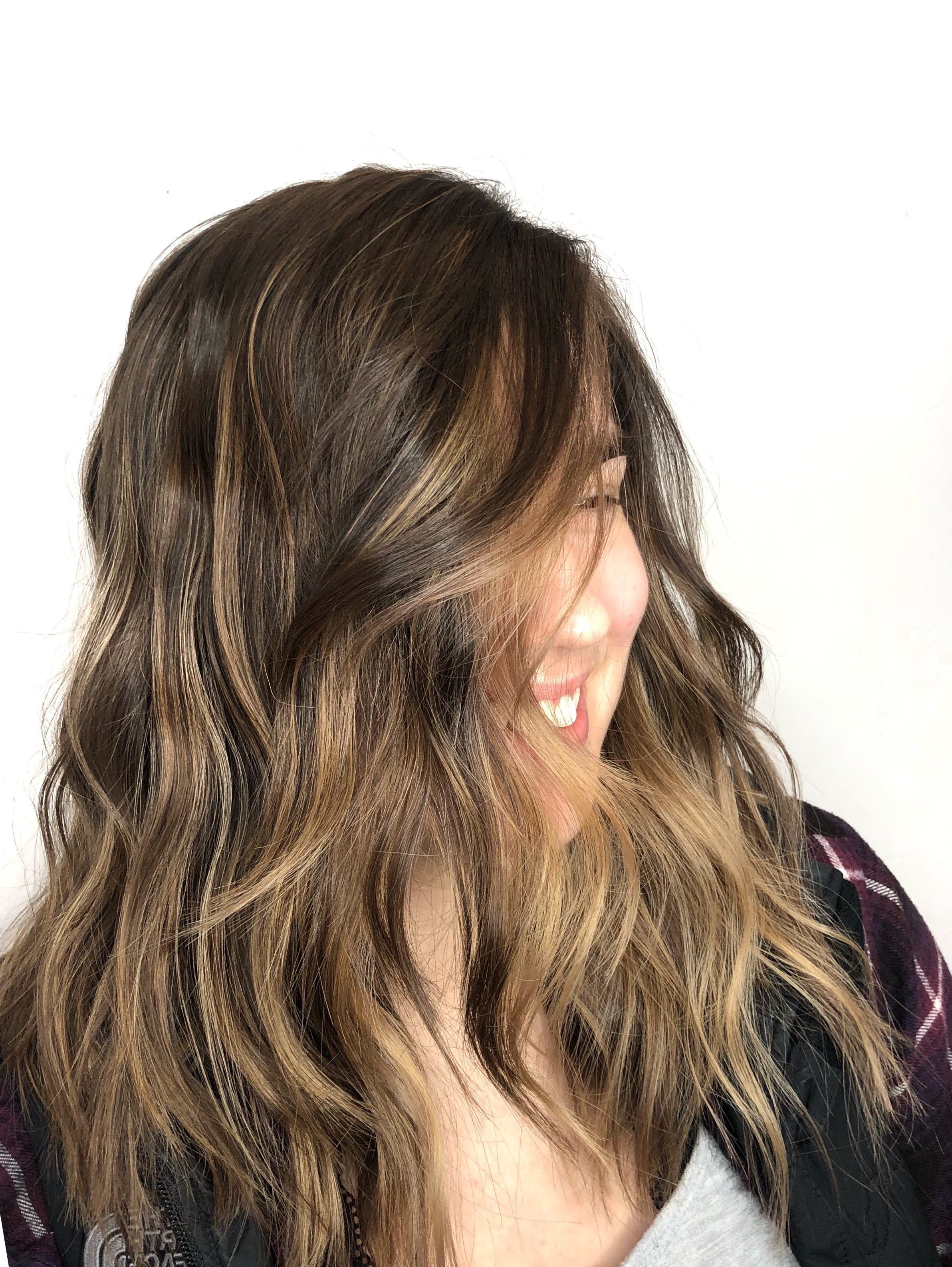What Is Balayage? - When someone wants to color their hair, they often want it to look as natural as possible. It can be hard to work those dyes in with your current hair color in a natural way, and this is where balayage comes in to solve that problem.Balayage is a hand-painted style of coloring that creates natural, intertwined colors in your hair to make a final look that's authentic, beautiful, and transformative. The process depends far more on a freehand, personal touch compared to other services we offer, but the end result is a hairdo with a sun-kissed, natural look that grows in a softer fashion compared to traditional coloring methods. You'll also have far less maintenance with your hair, as an added bonus!Want to learn more about balayage or schedule an appointment with the best place for balayage in Salem, OR? Send me a message today, and let's get you the hair you've always wanted!