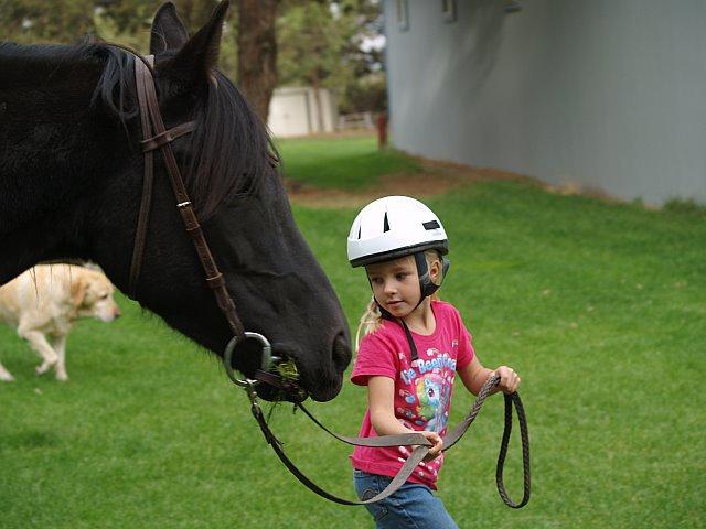 girl-walking-horse.jpg