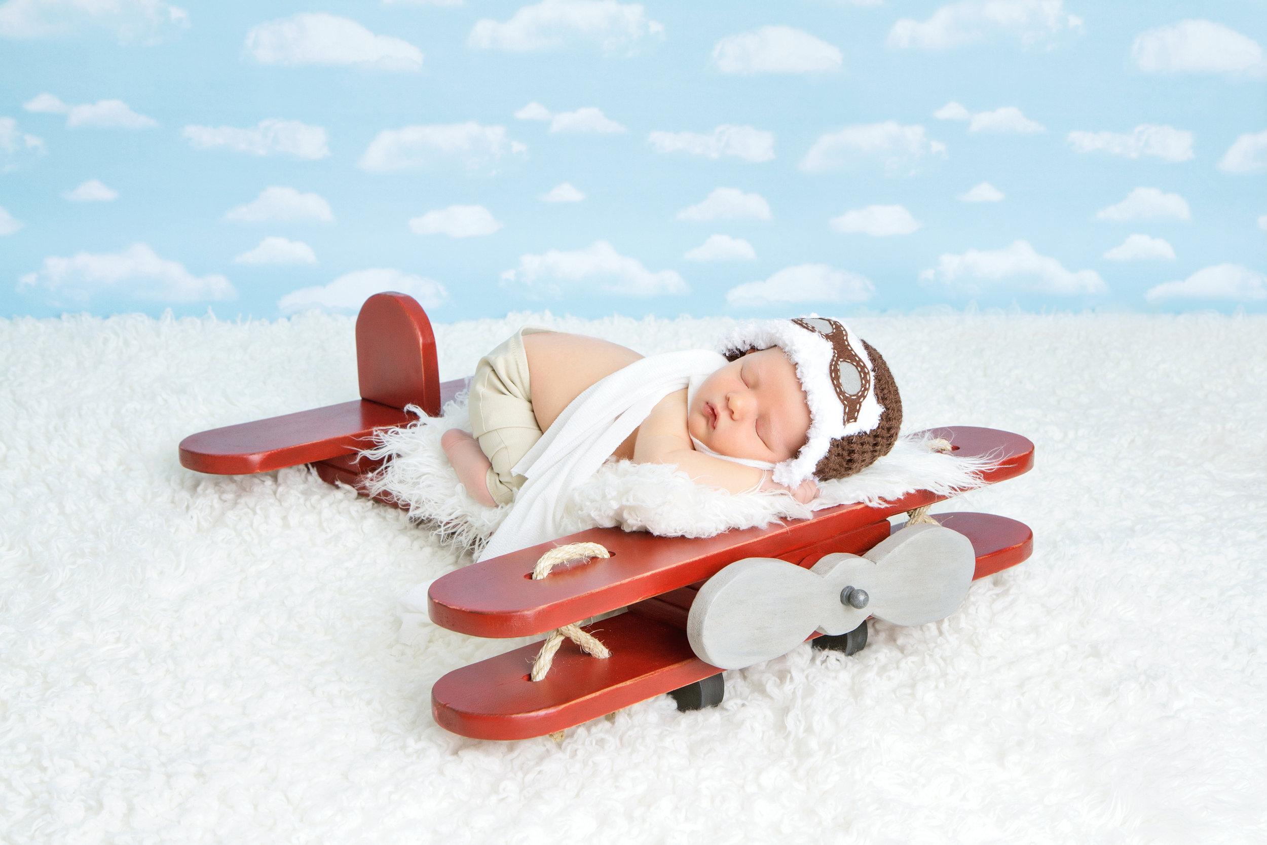 newborn boy red airplane.jpg