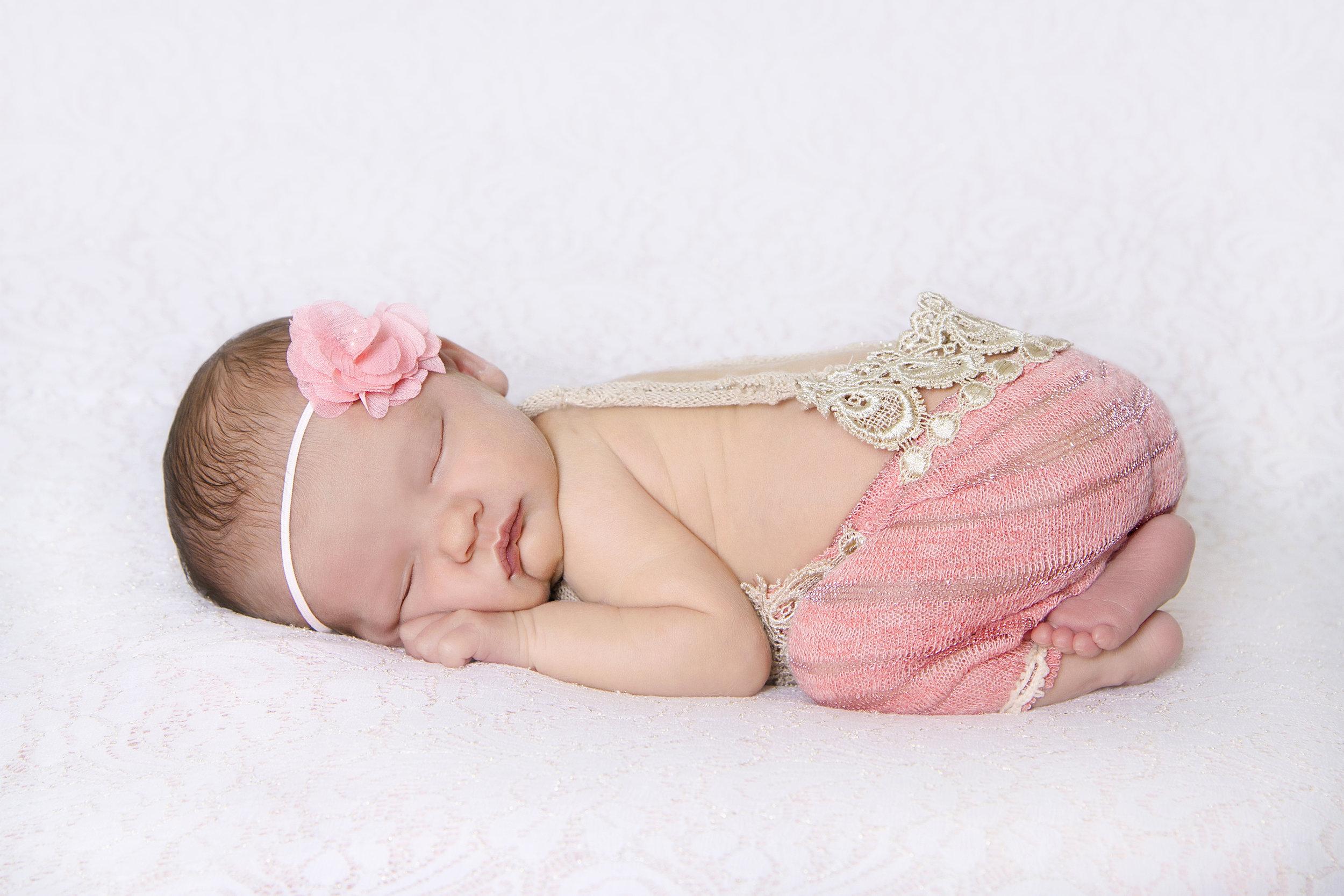 newborn girl coral romper.jpg