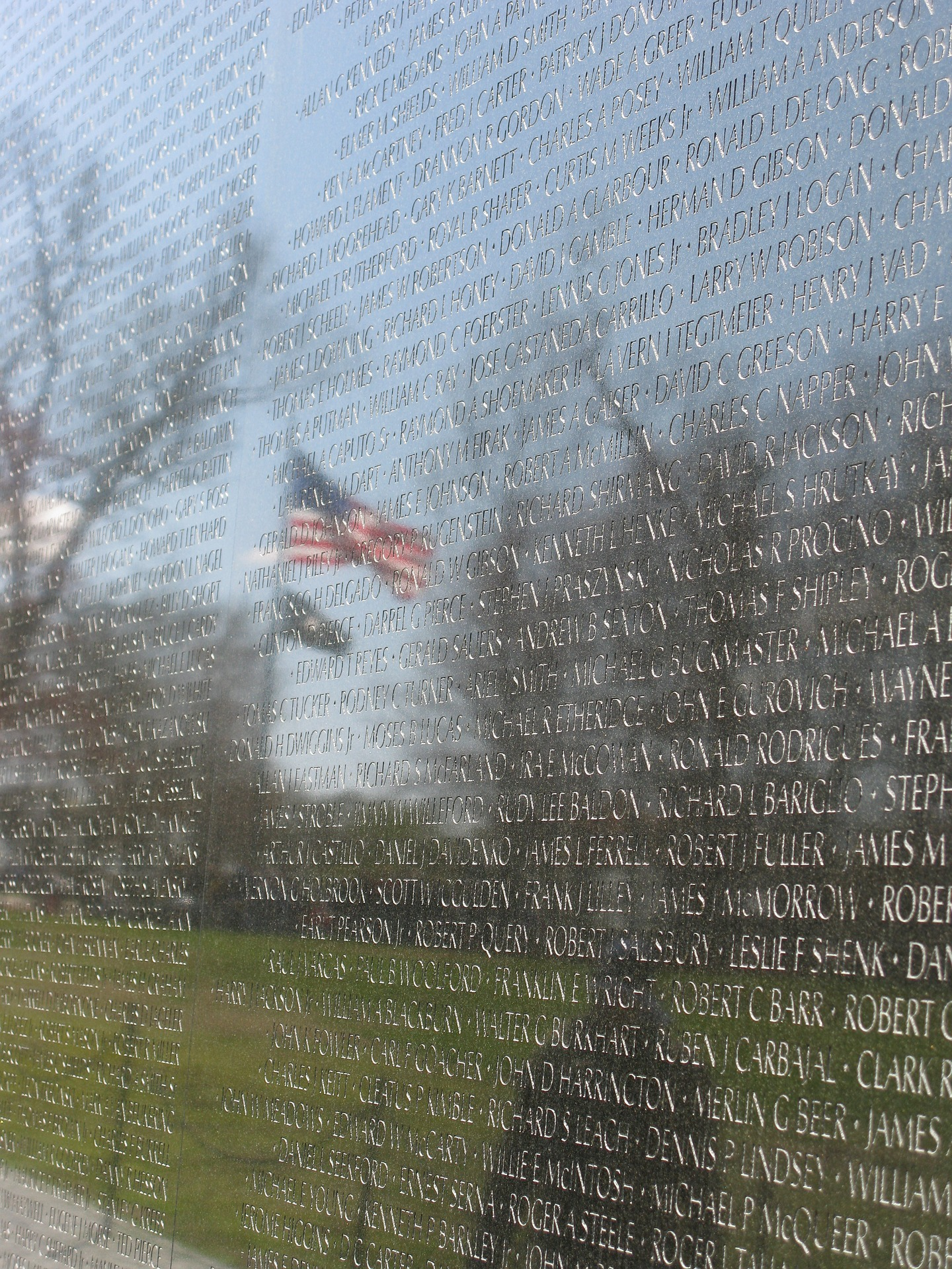 The Vietnam Memorial in Washington DC with a subdued reflection of the American flag, and the POW-MIA flag below it. Hispanics only represented 4.5% of the US population in 1970, but a study by Dr. Ralph Guzman showed Hispanics represented 19% of the casualties suffered during the Vietnam War (during the time frame studied).