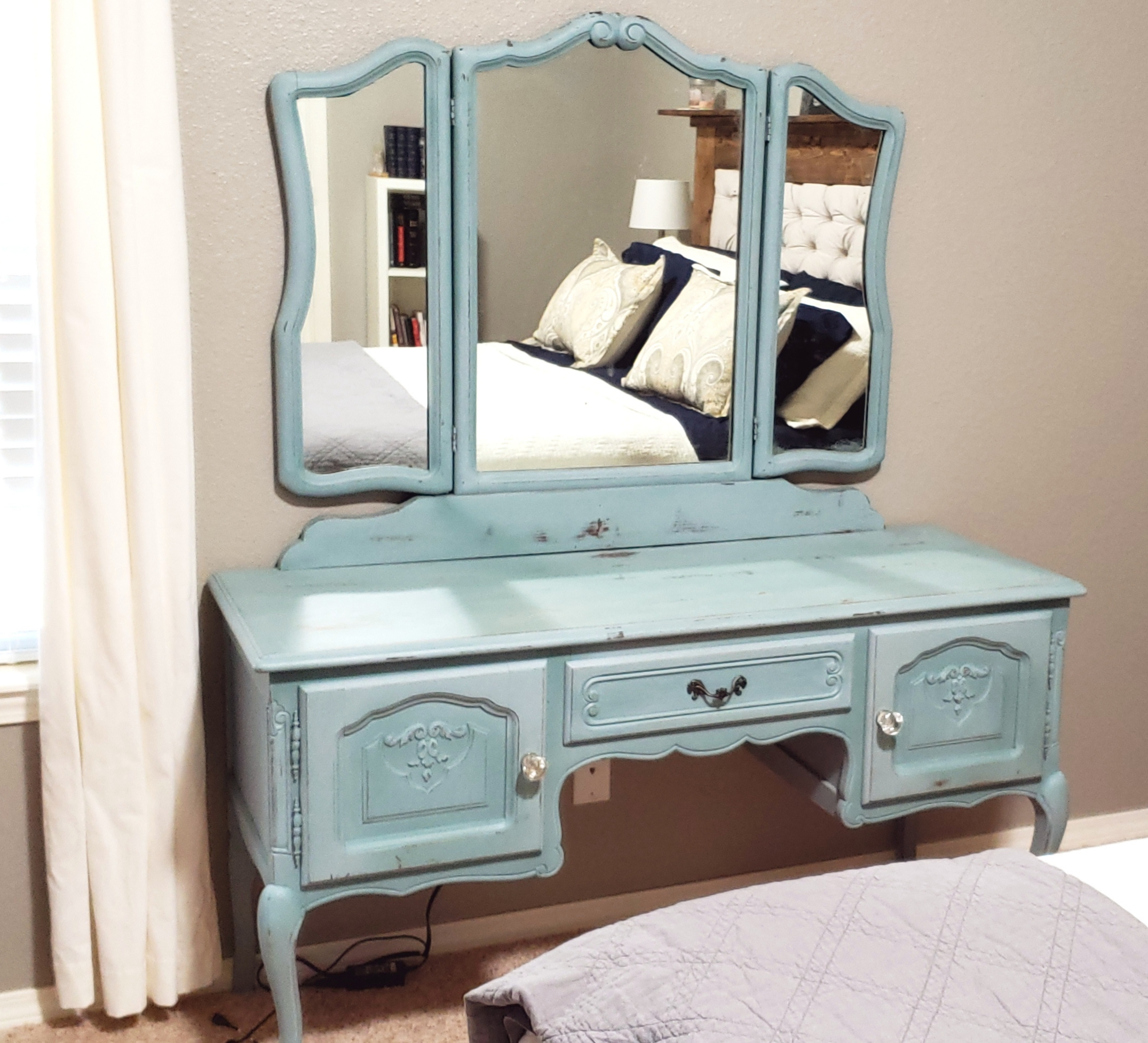 This is the antique vanity I use as my desk. I keep my budget binder here.