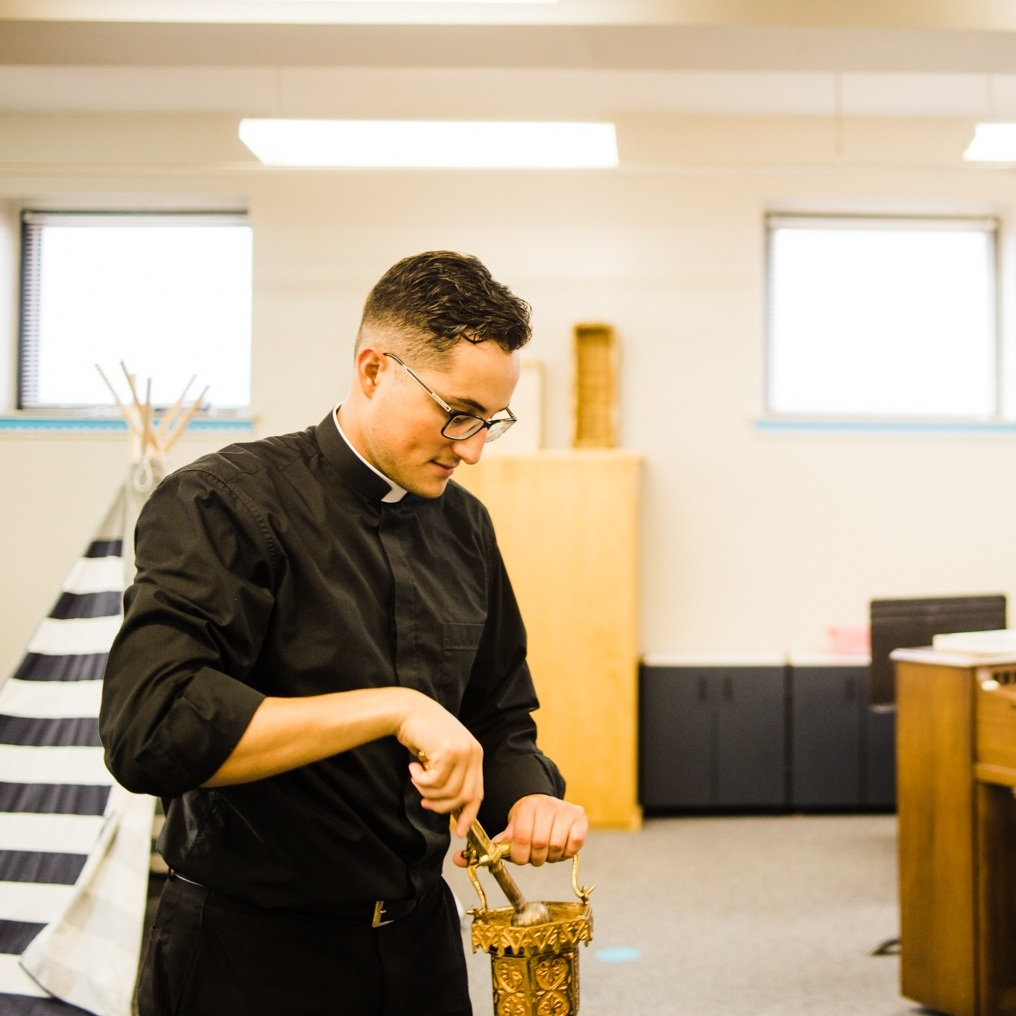 Father Carvajal blessed the music room on the first day of school at Holy Family Cathedral School in Tulsa, Oklahoma.