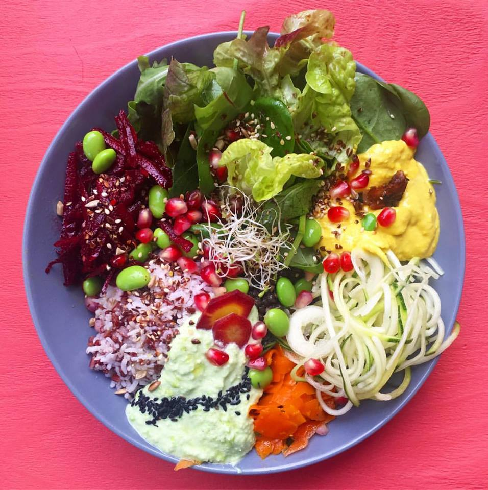 Healthy bowl at Mana Berlin filled with beetroot, zucchini spirals, edamame, salad leaves, rice and creams.