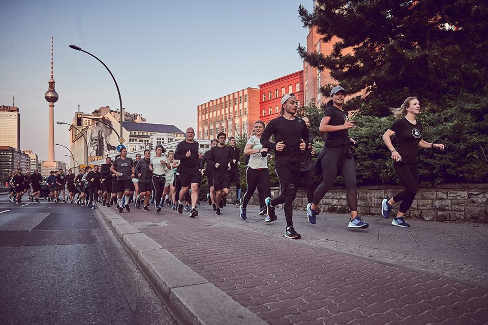 A group of Adidas runbase runners with Berlin television tower in the background