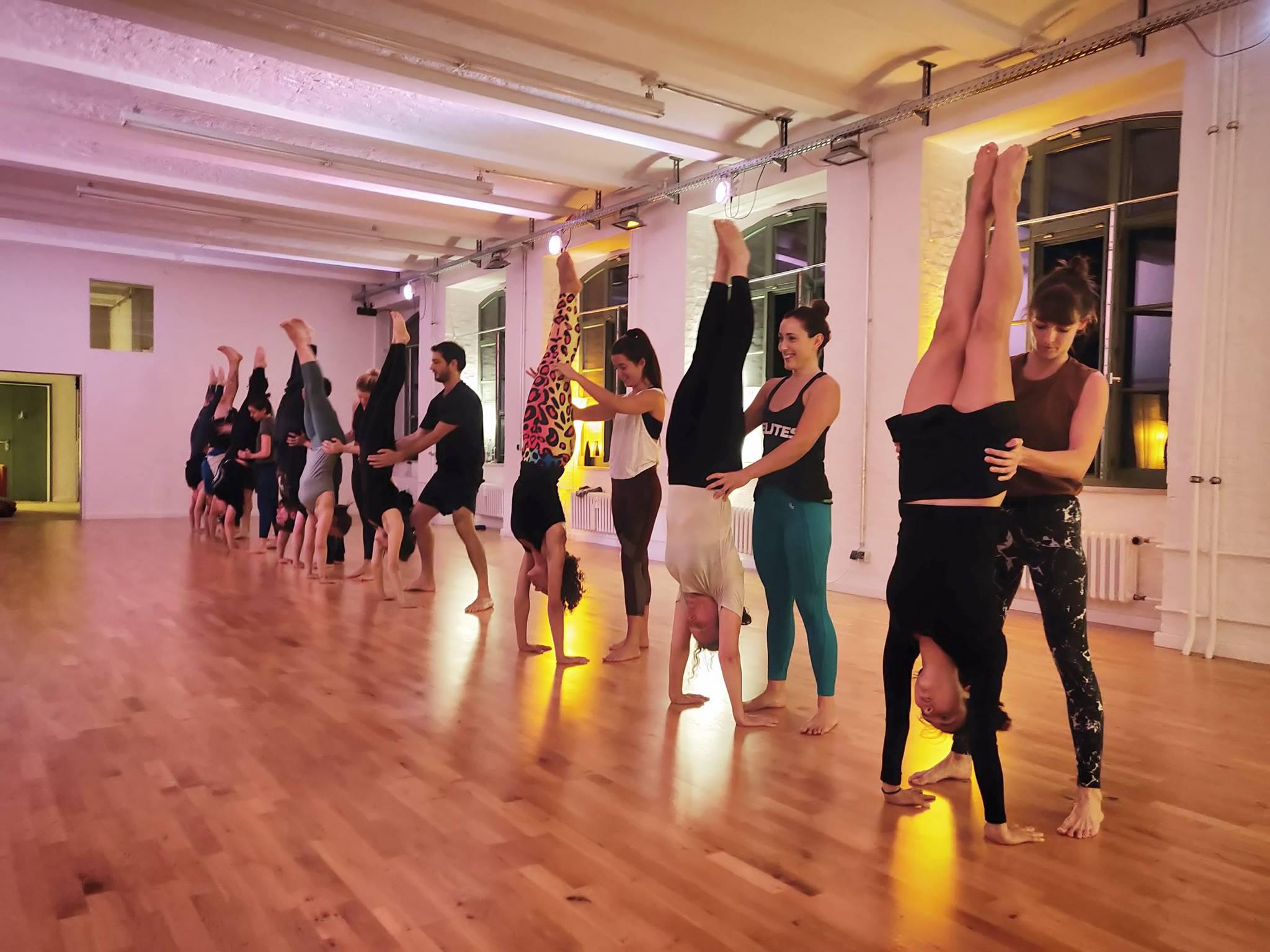 Handstand practice with partner at Inverted World studio Berlin