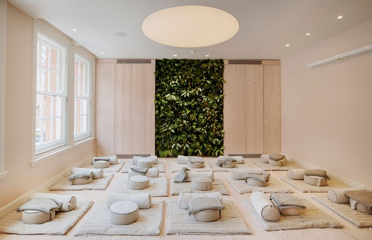 Beautiful meditation room with blankets and seat cushions in nude colours at Re:mind London.