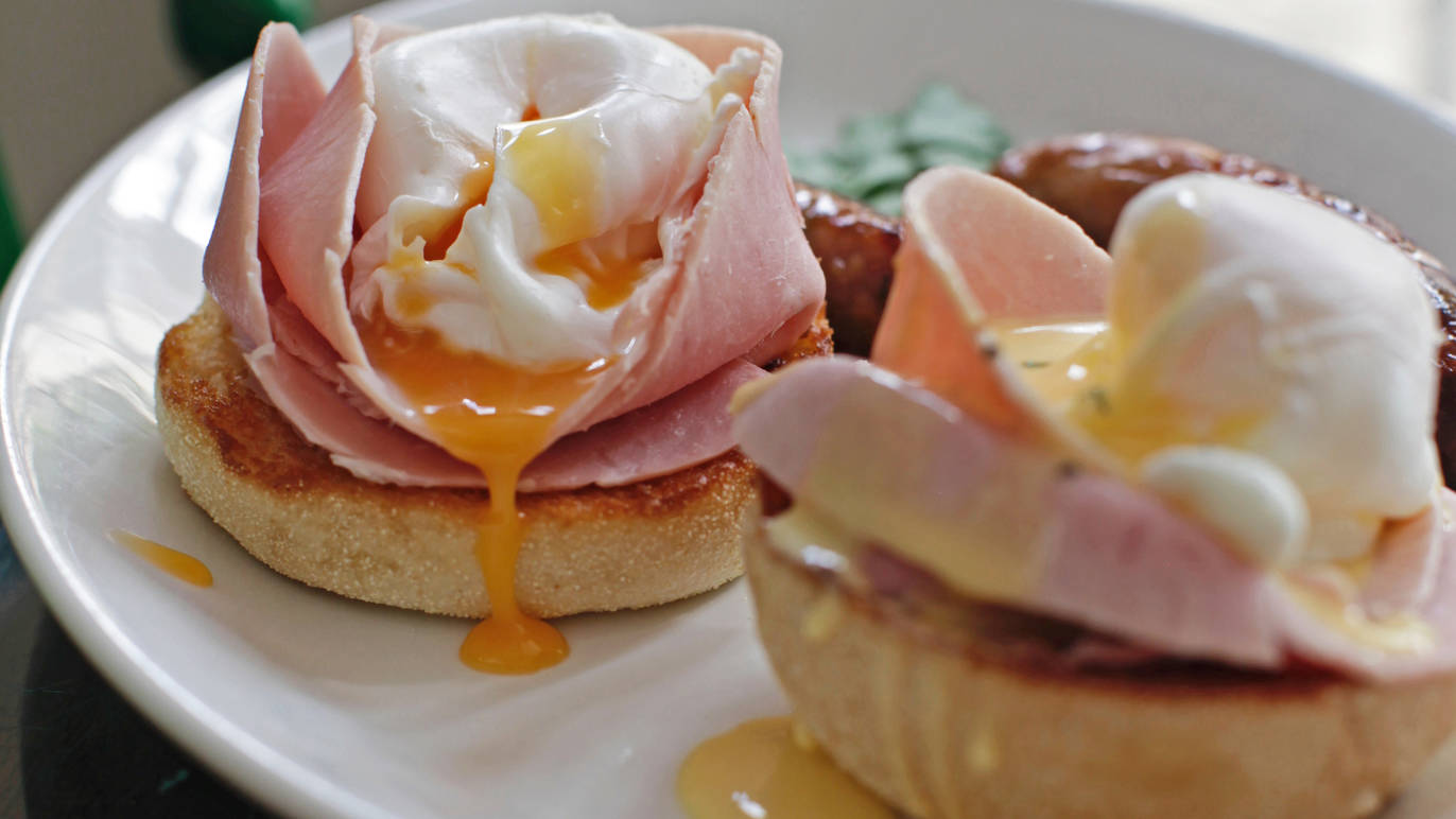 Poached eggs on ham and brioche at Tomtom coffee London.