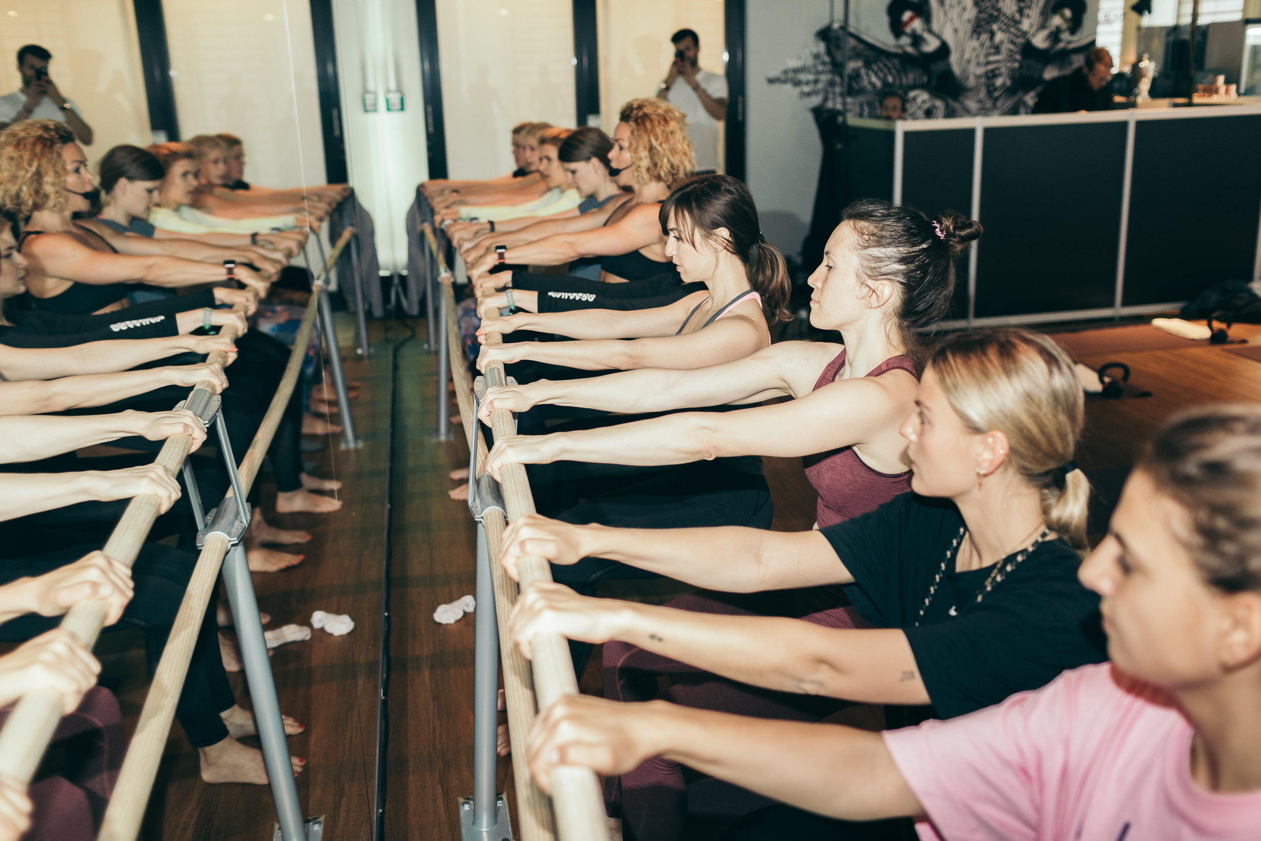 Girls working out at a ballet barre with Alex Hipwell