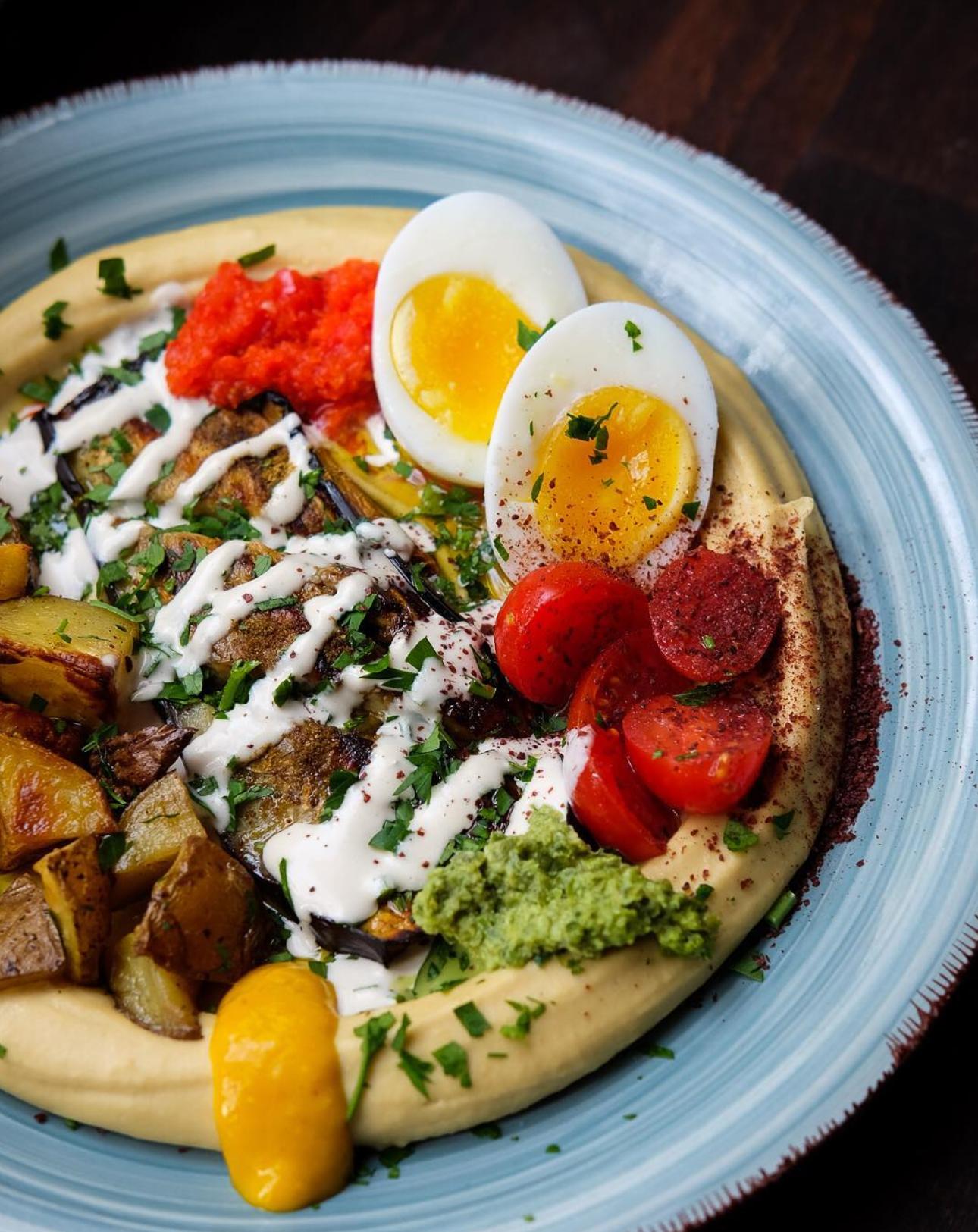 Hummus with tomatoes, eggs and potatoes at Cafe Mugrabi Berlin