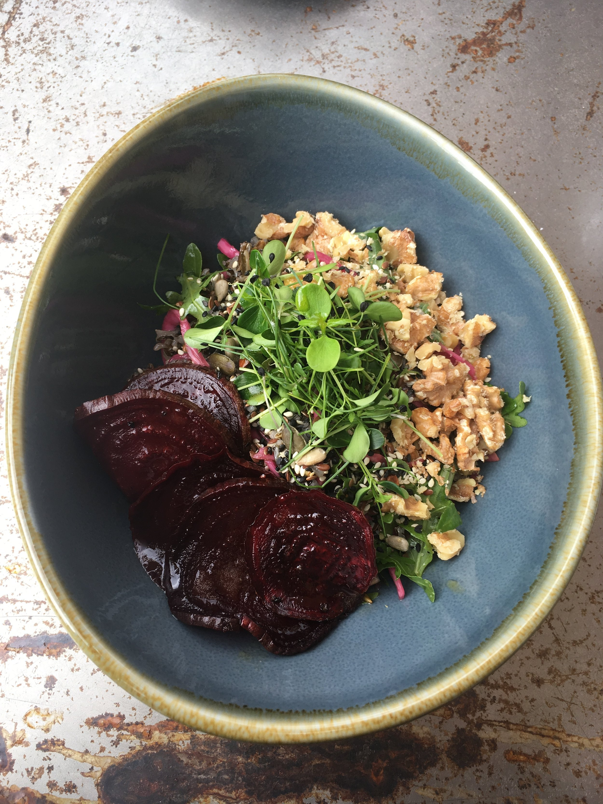 It's a bowl dish at 19 Grams Berlin, with sauerkraut, seeds, walnuts, rockets, black rice and roasted pepper beetroot.