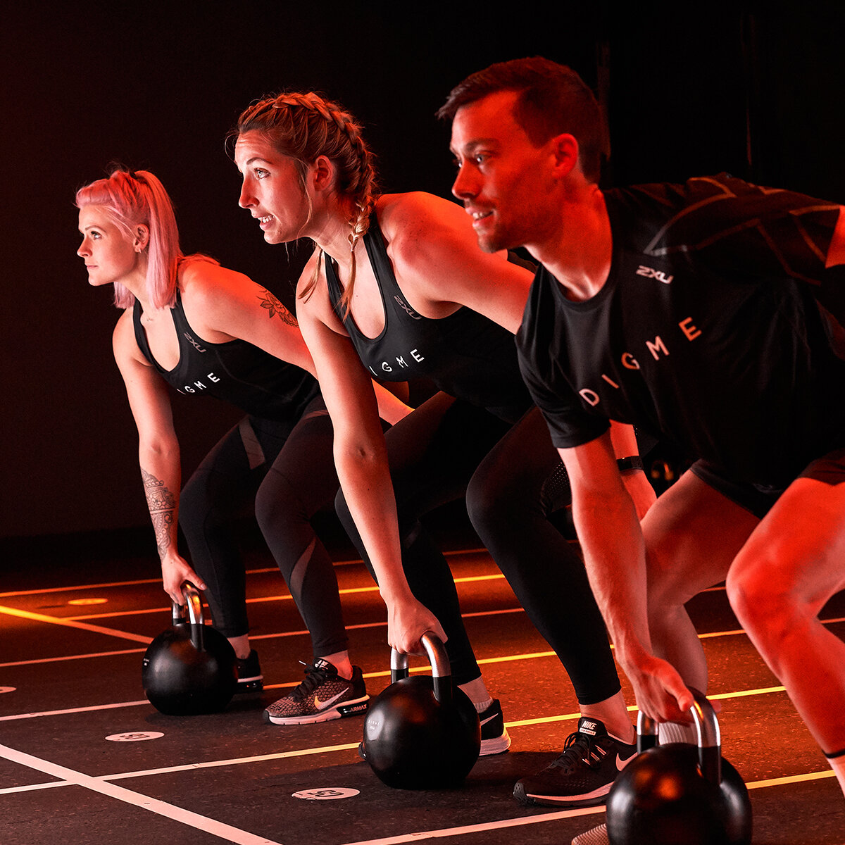 Group holding kettlebells during a Matrix full body workout at Digme London.