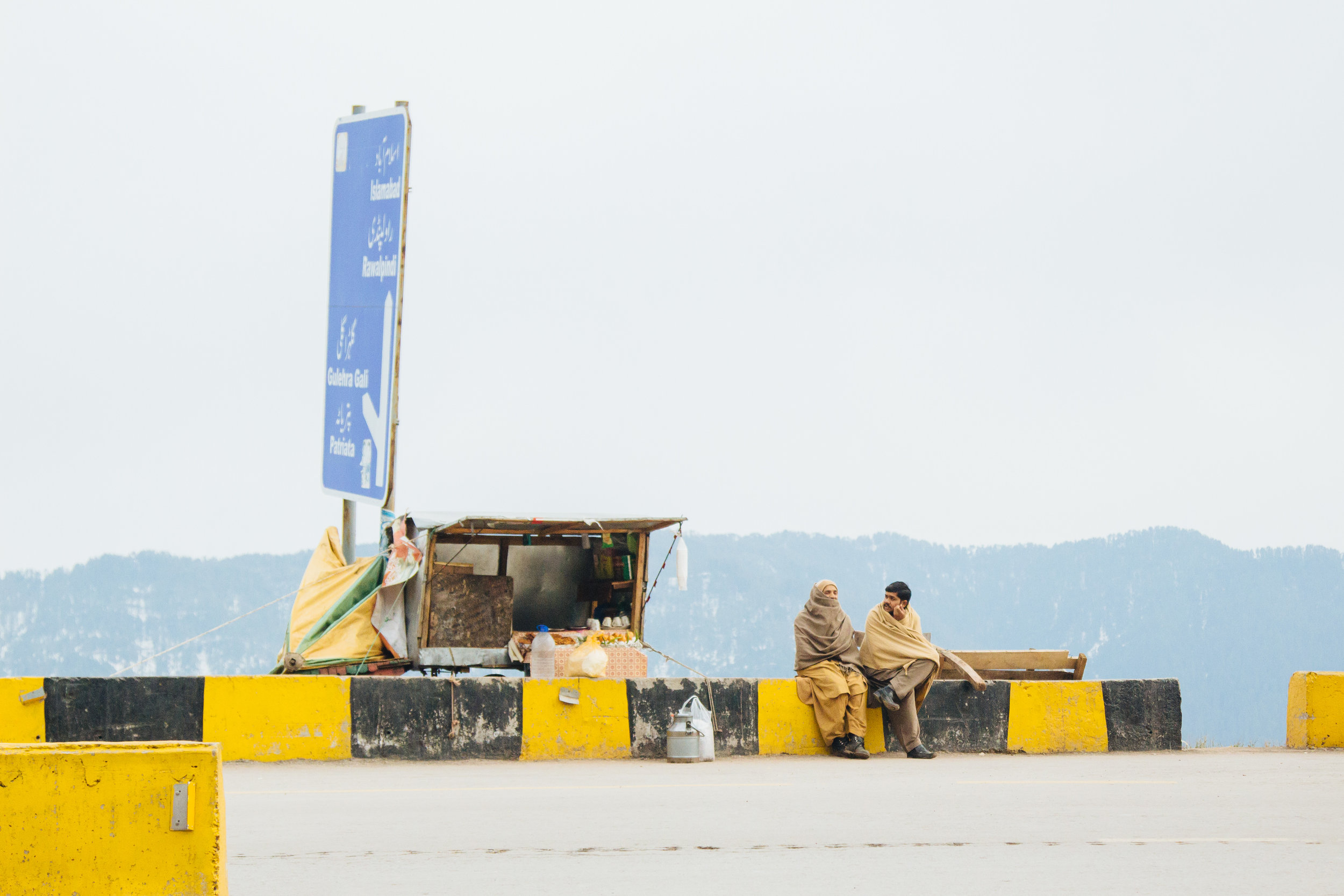Vendors sell snacks to passing travellers