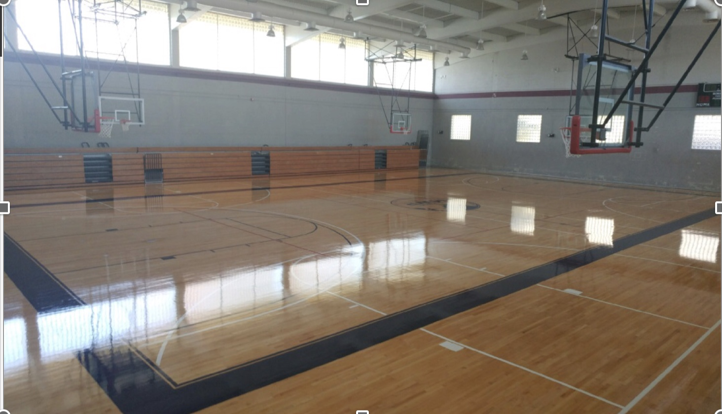 Title/Location:     Athletic Courts Installation/Repair  Customer Name: Department of United States Army; Hosking Physical Fitness Center, Hercules Physical Fitness Center Bldg; Fort Bragg, North Carolina   (Photo 1  of 2)   Installed and repaired Basketball courts.  This project required installation or repair of existing hardwood flooring, including resurfacing, finishing, sanding, application of oil based urethane coating, and re-striping and marking of athletic court lines.  Carolina Group's team provided all labor, equipment and materials necessary to complete to project, as well as debris removal and cleanup. Carolina group performed all ancillary work including installation of doors, door jams, suspended acoustical ceiling system, LED lighting, and H VAC assessment and renovation where necessary.
