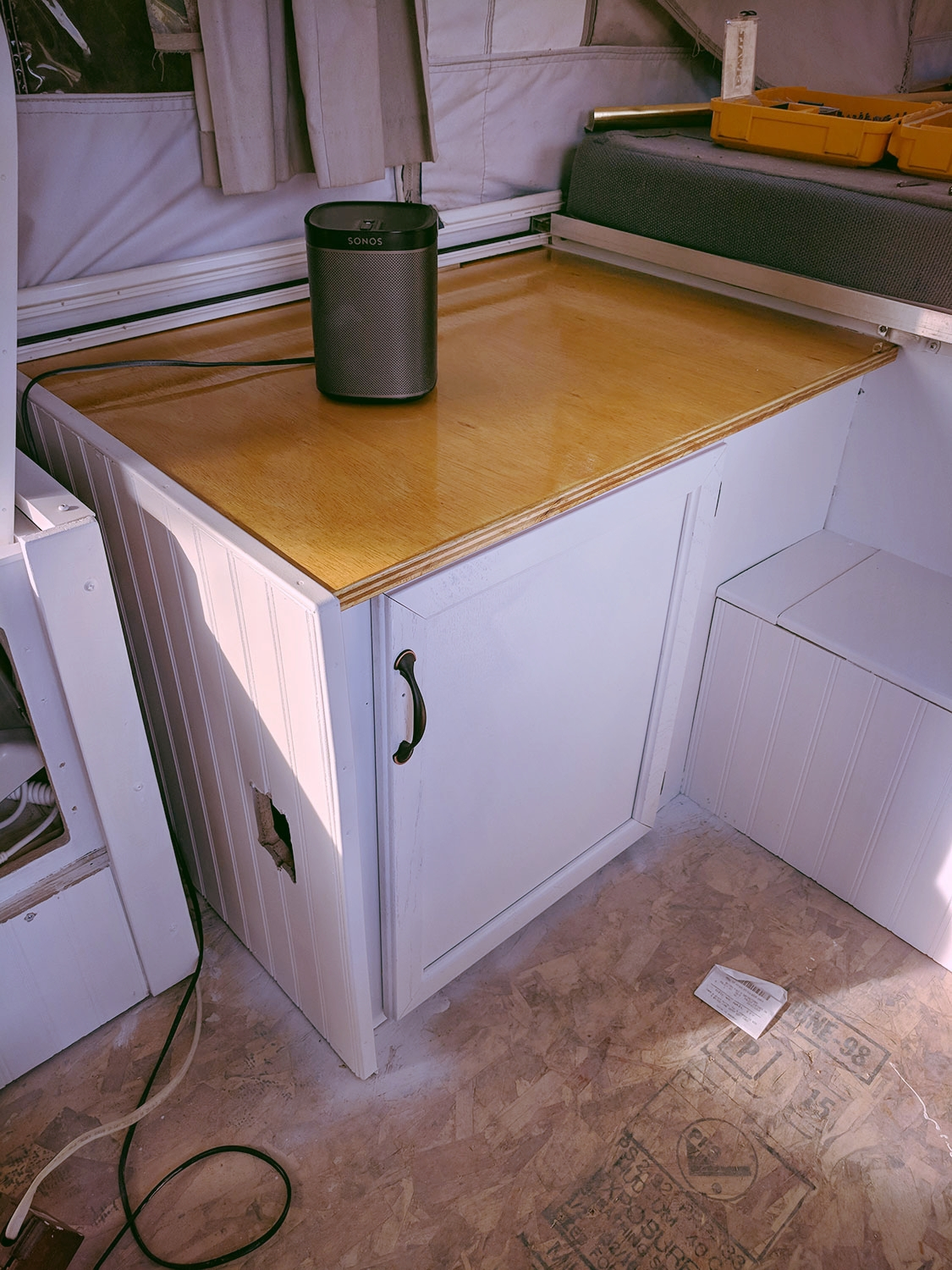"""An """"in progress"""" interior shot of  the Diane  - a new counter top, wainscoting, and some fresh paint. It's a start!"""