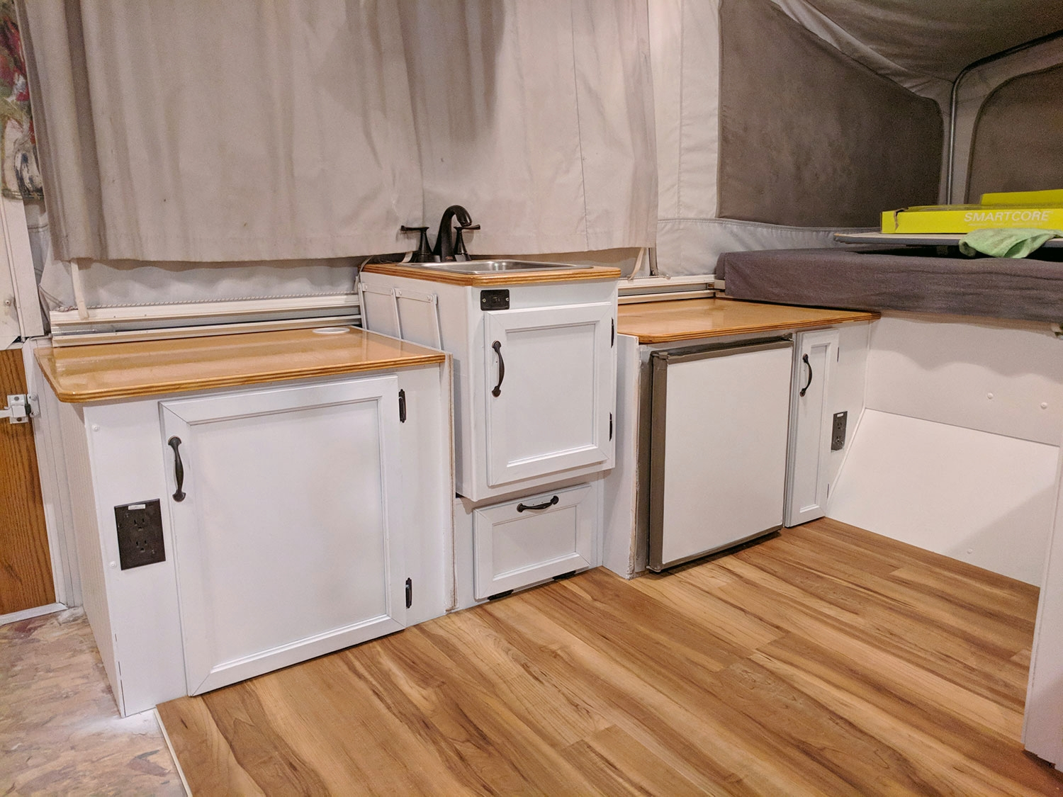 """An """"in progress"""" interior shot of  the Diane  - another counter top, more wainscoting and fresh paint, and finally the new floor is going in."""