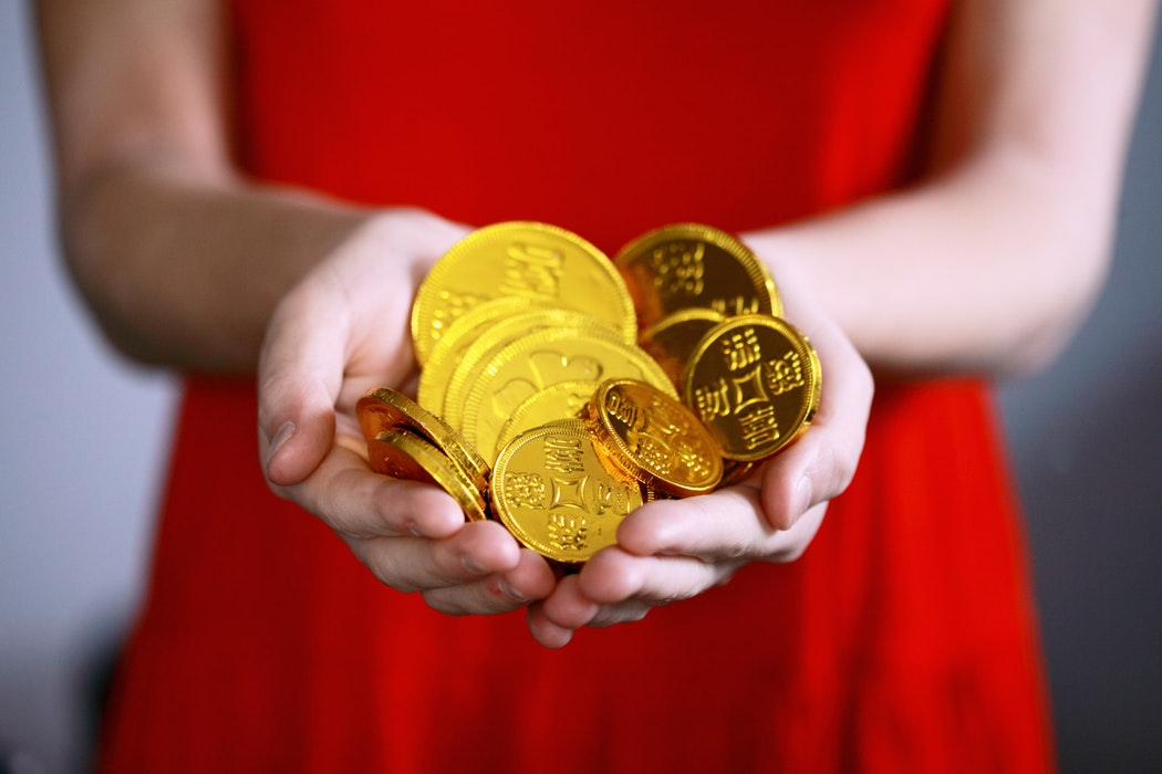 photo-1517097473408-c0d7983cb95c woman with gold coins.jpg