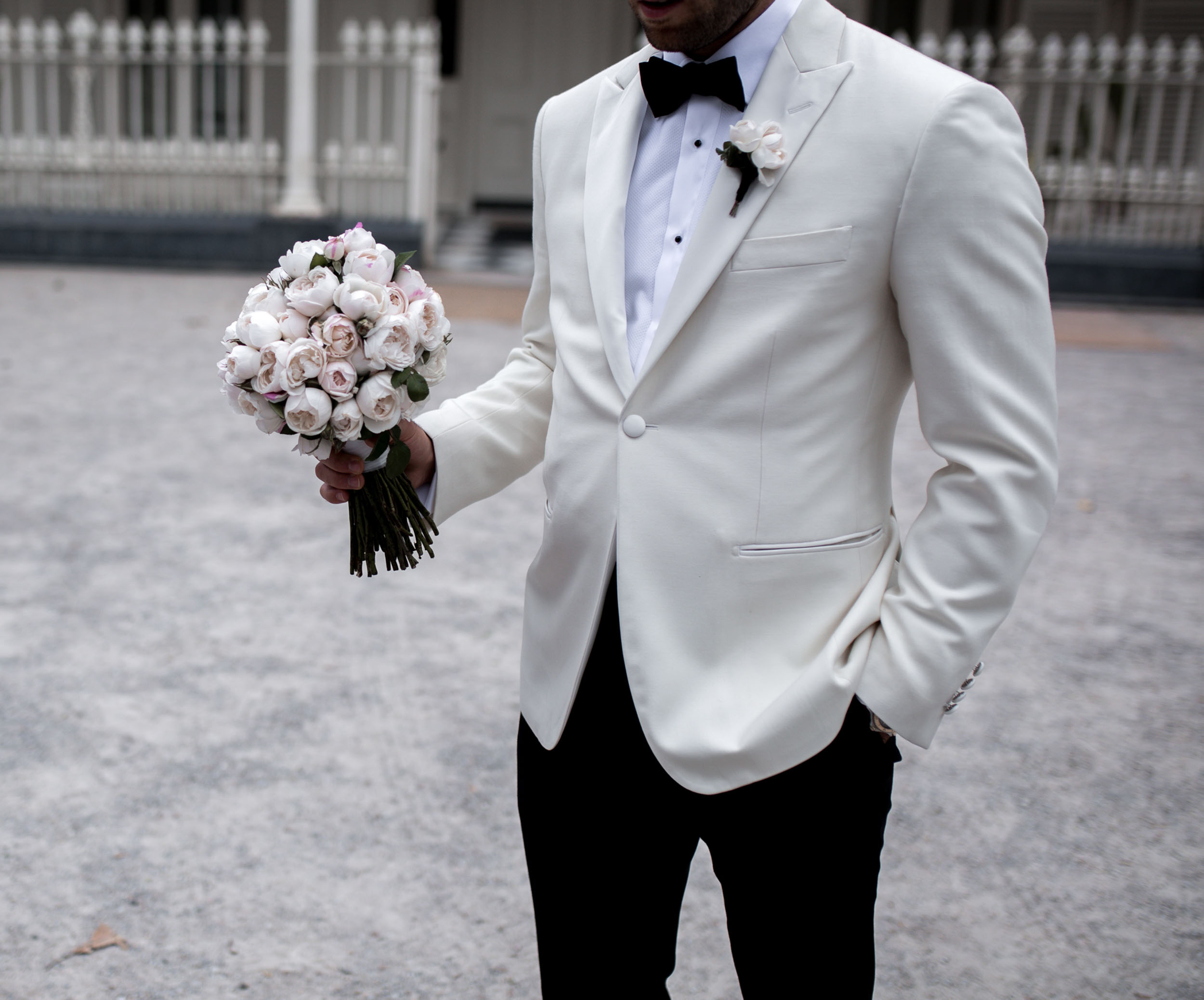 THE GROOM - Jonathan wore a classic Oscar Hunt suit paired with Hugo Boss shoes.