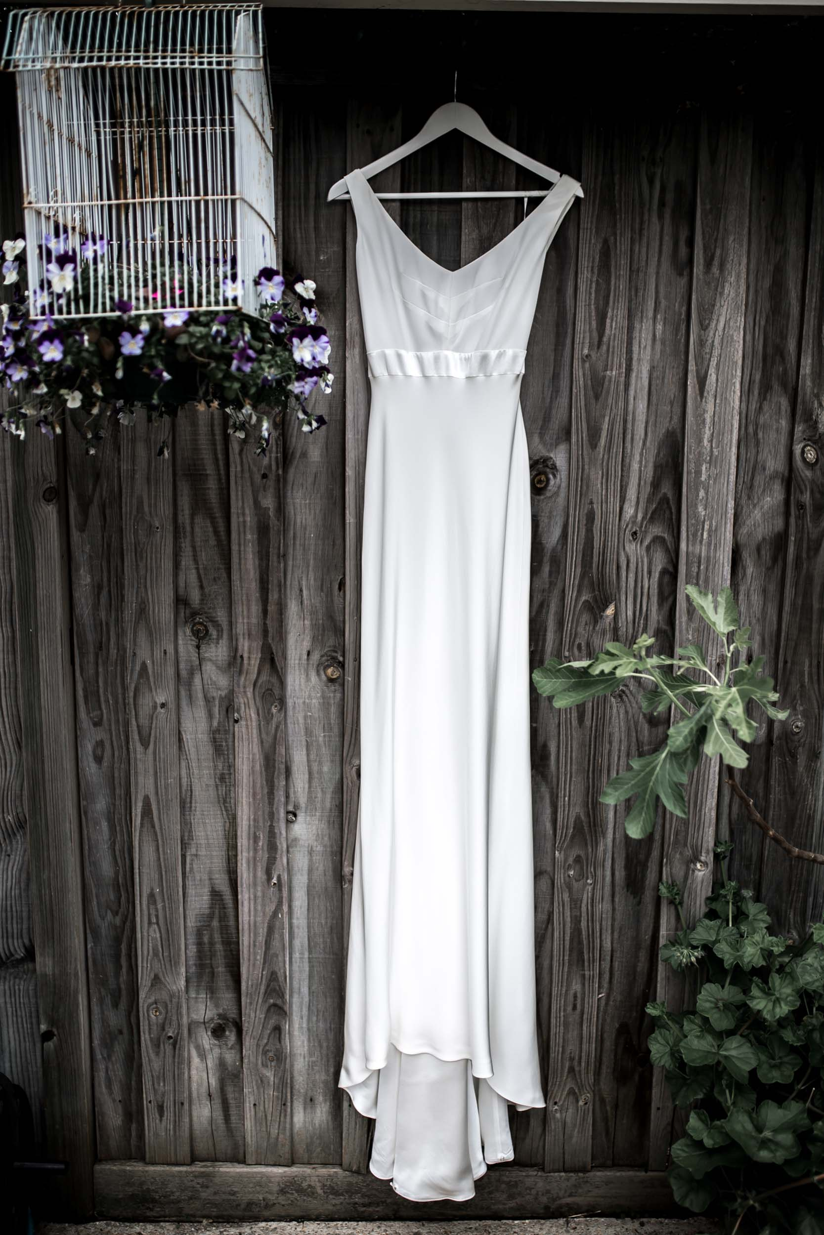 THE BRIDE - Jessica wore a sheath Sabina Motasem gown from Bluebell Bridal.