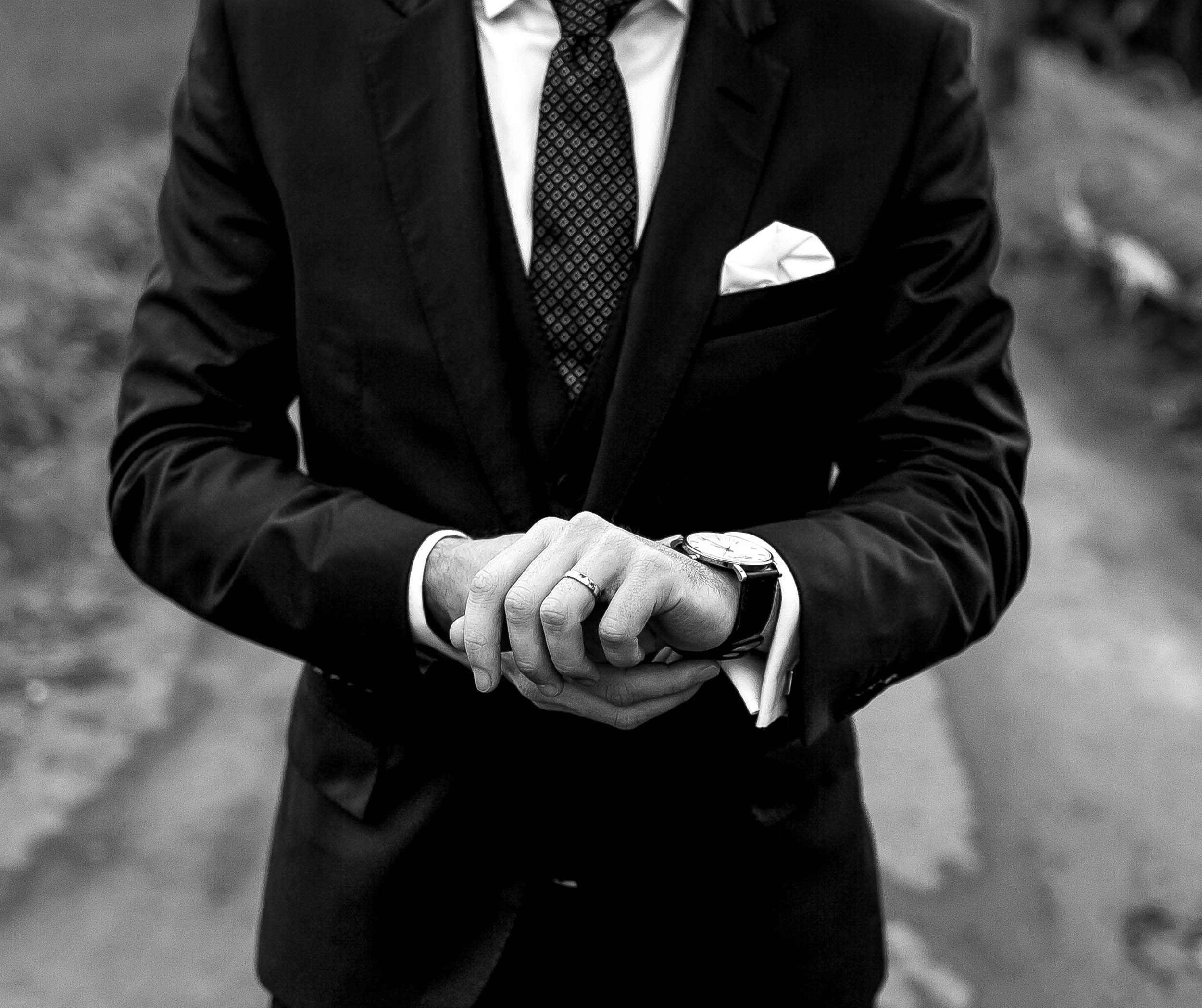 THE GROOM - Brendan wore a classic black suit with patterned tie.