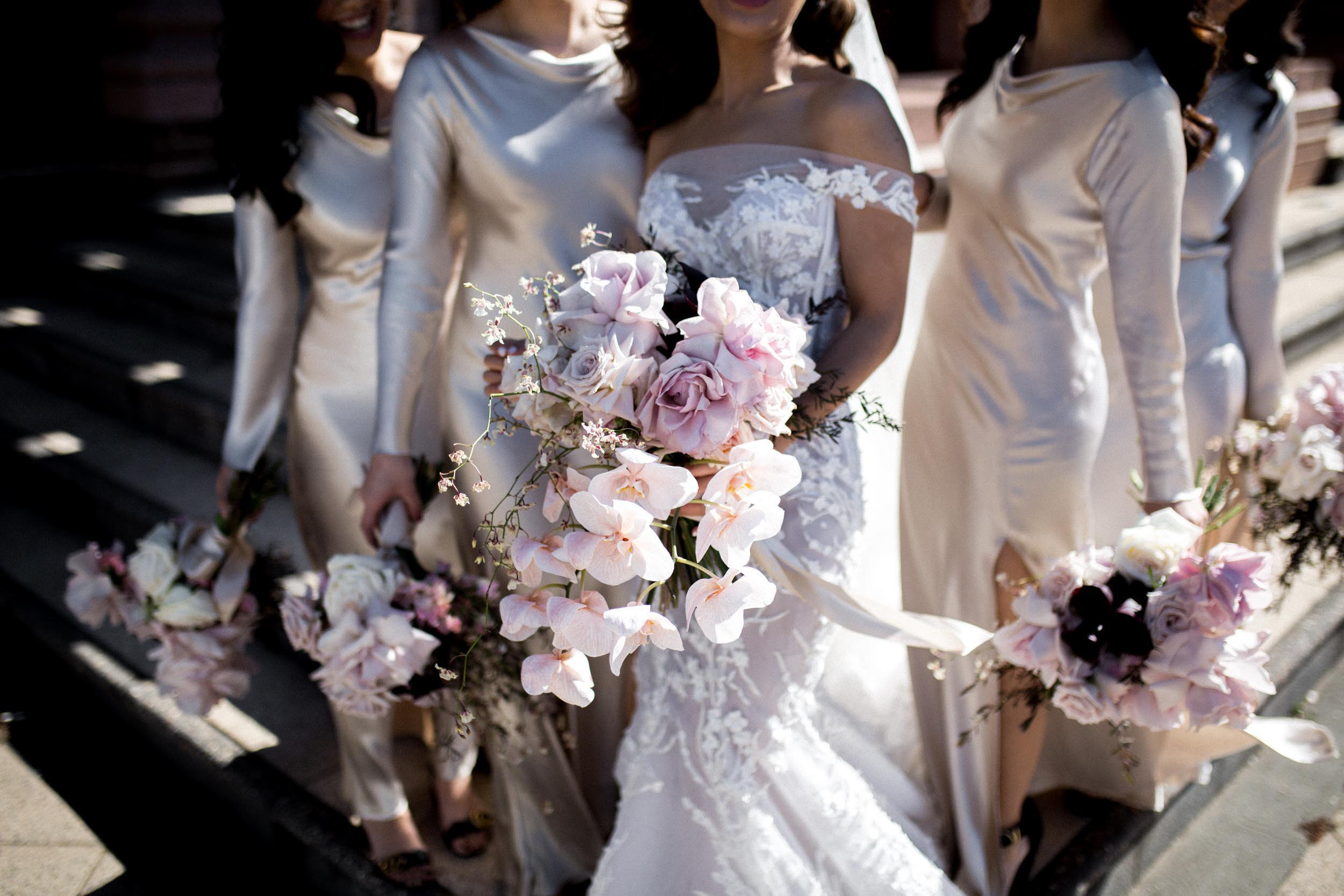THE Flowers - The bouquets were made up of pastel sorbet coloured orchids and roses by Sydney florist, Poho Flowers.