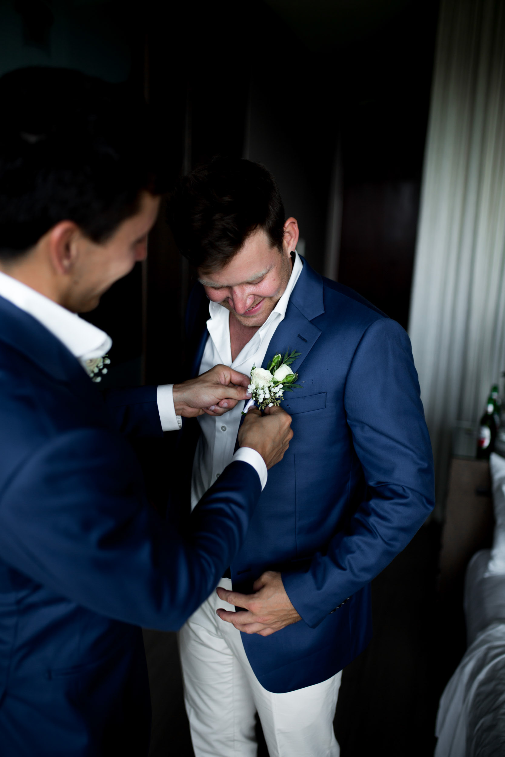 THE GROOM - Sam and the groomsmen chose navy blue jackets paied with beige chinos from Institchu rolled up at the cuff with leather brown loafers.
