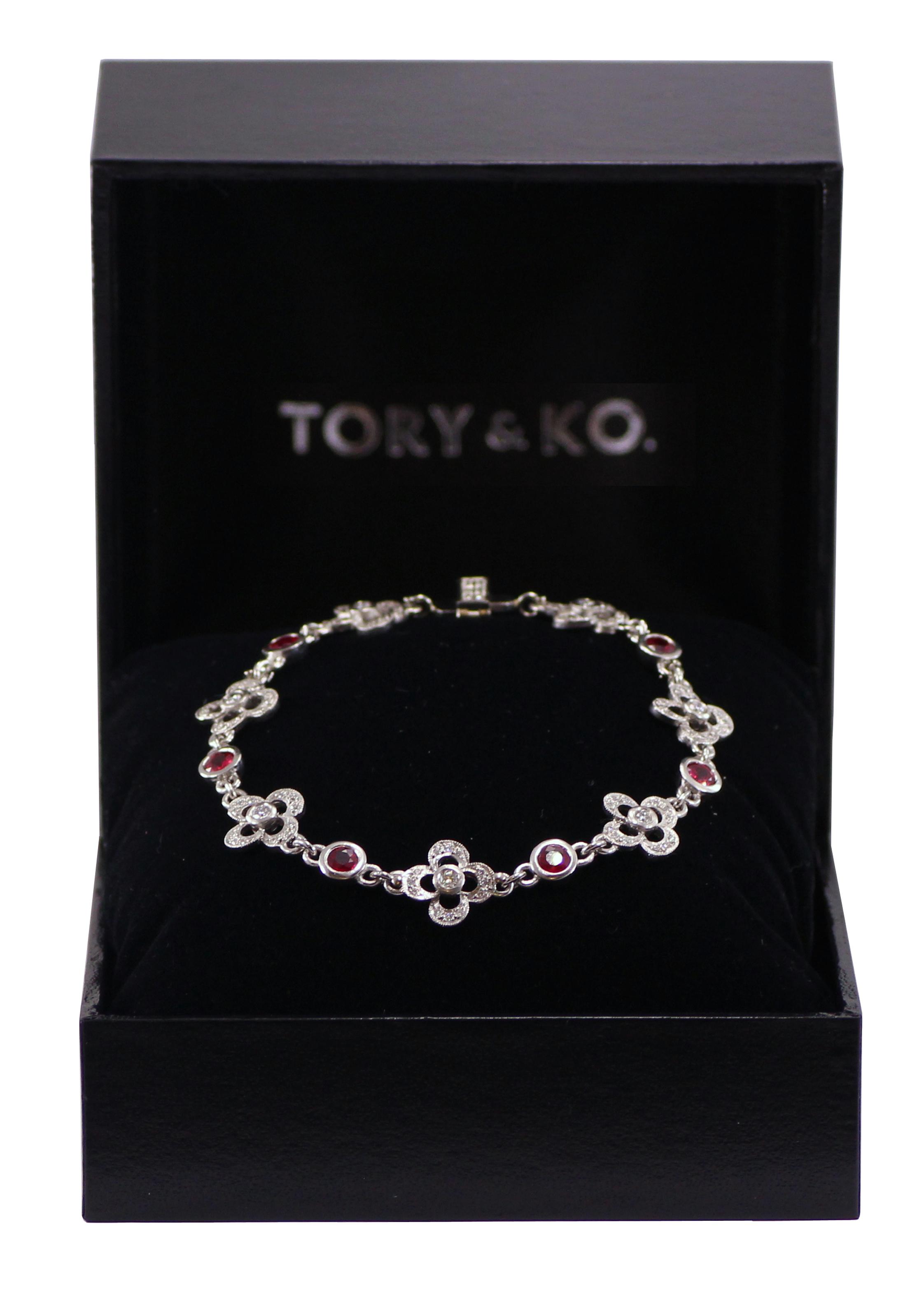 Ruby and diamond Flower bracelet.jpg