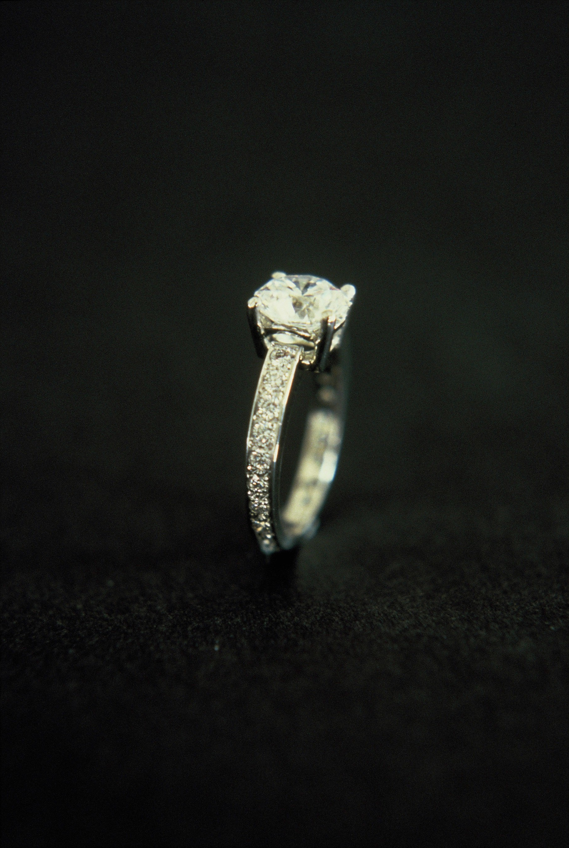 Round Brilliant Diamond Ring with Grain-set Diamond Band