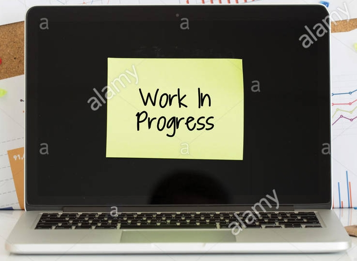 work-in-progress-sticky-note-pasted-on-the-laptop-screen-G5XK9W.jpg