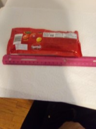 Skittles package with ruler