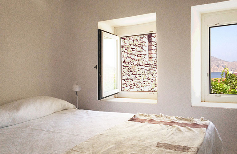 PACKAGE 2 - DOUBLE ROOM WITH SHARED BATHROOM  Features: Double bed, air conditioning, common bathroom (sharing with one other room) / kitchen / lounge area and terraces