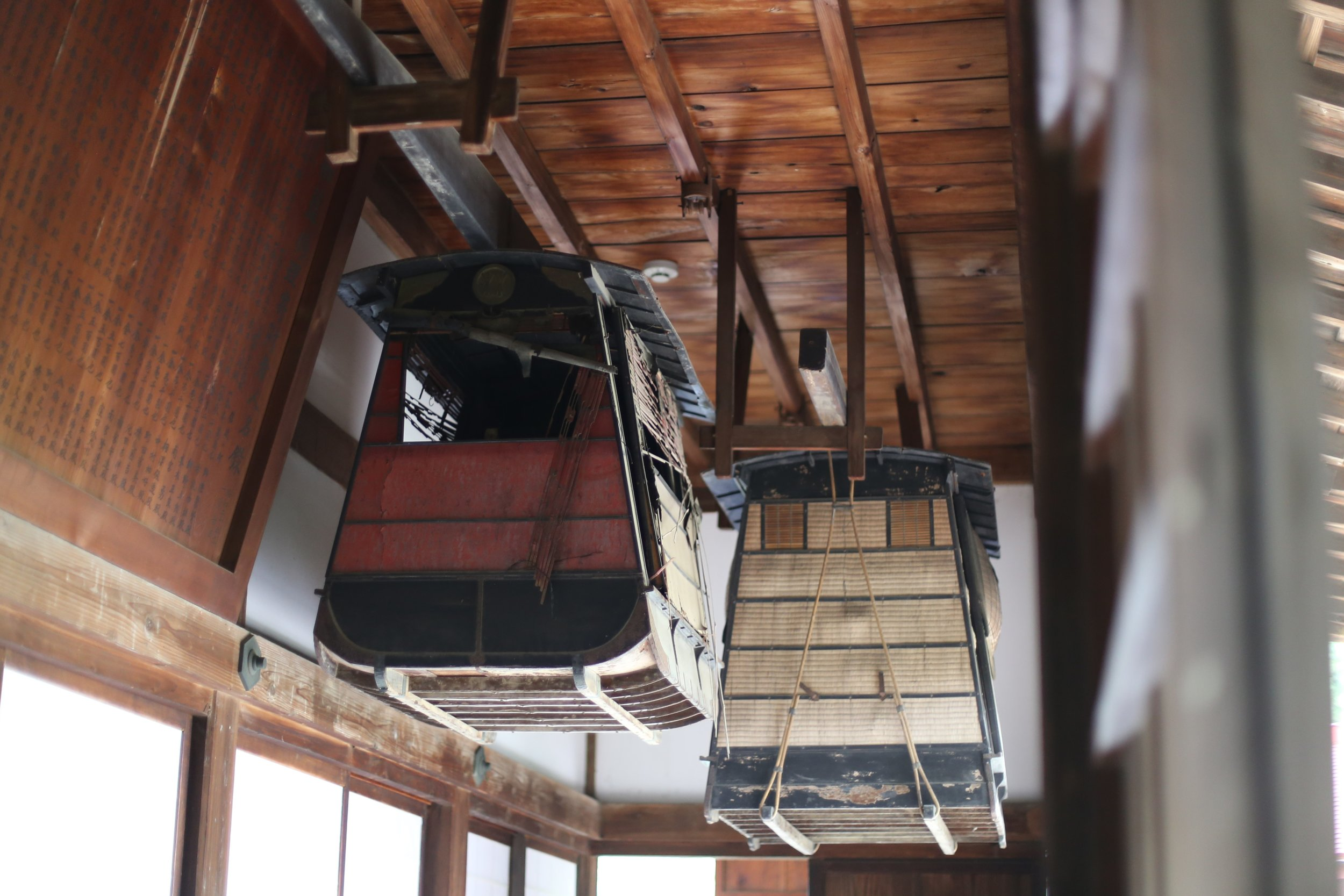 Carriages called  daimyo kago  used to carry Edo Period feudal lords on the  Koshu Kaido , seen here hanging in the Hokoji Temple in the north of the valley.