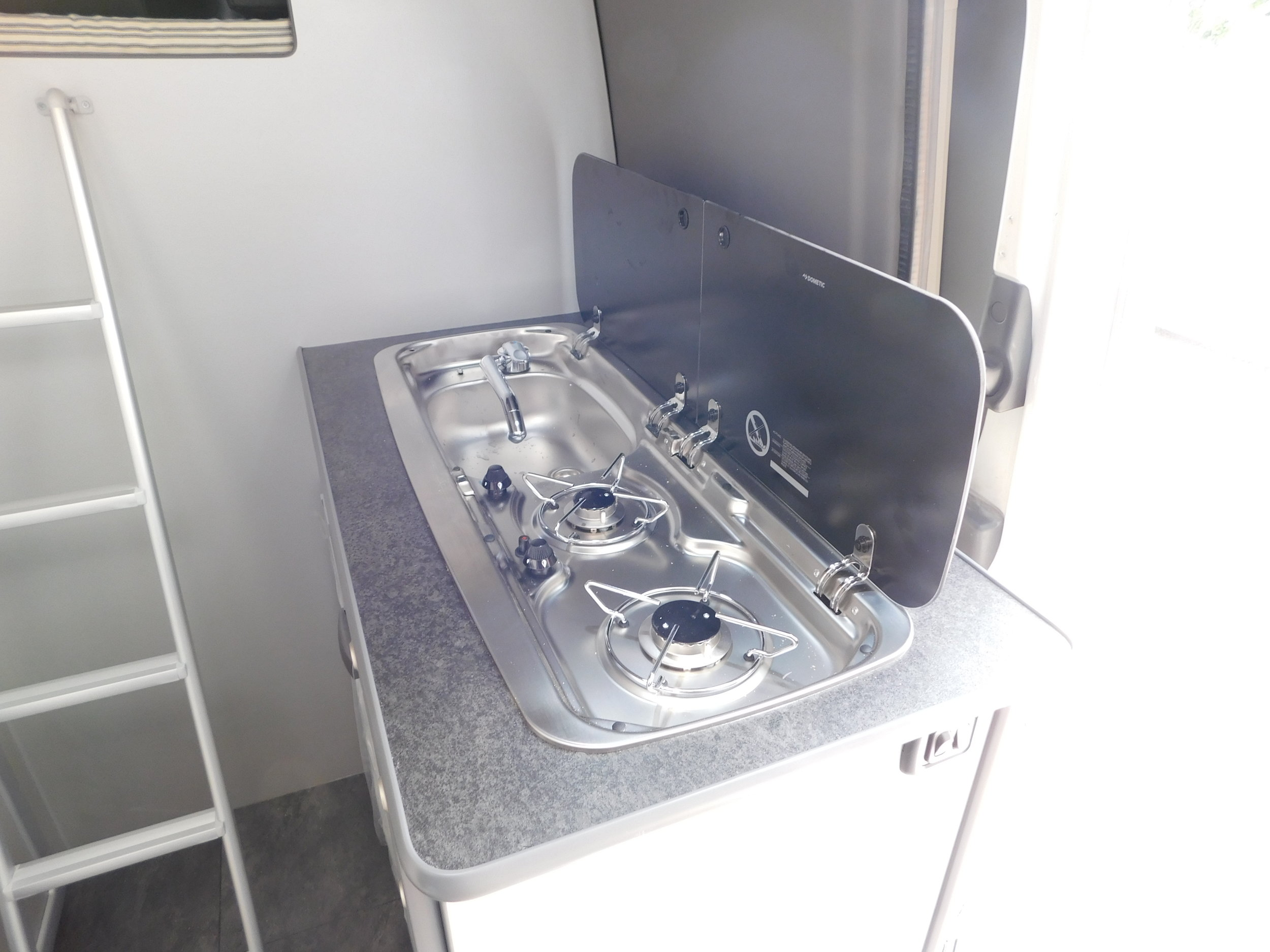 2 Hob gas stove + sink combination and a 12V fridge