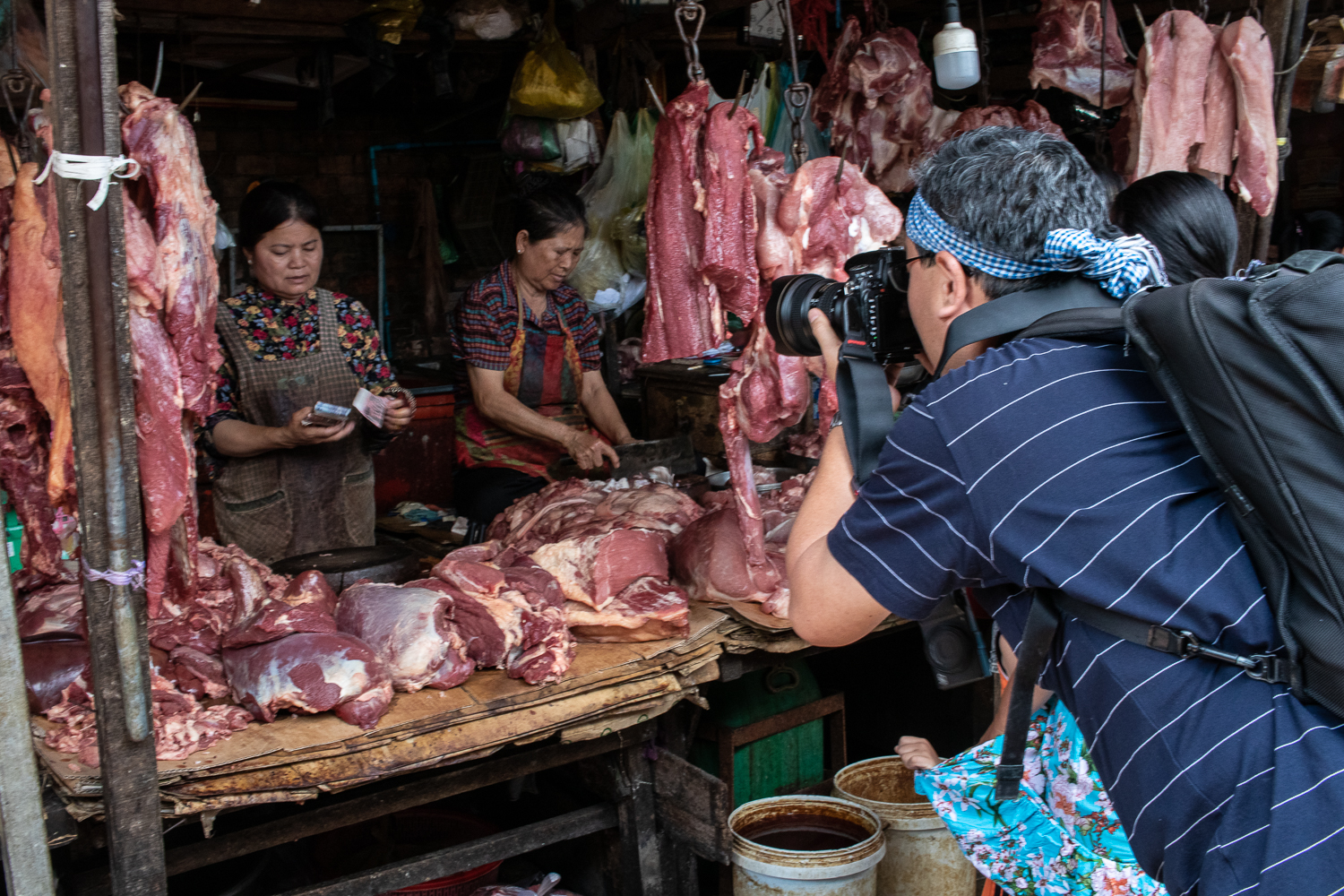 Akira capturing the action at a local wet market on the one day street photography workshop.