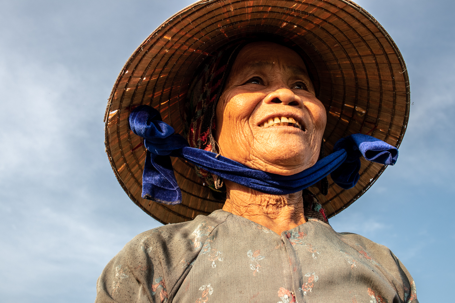 A beautiful Vietnamese farmer in a conical hat.