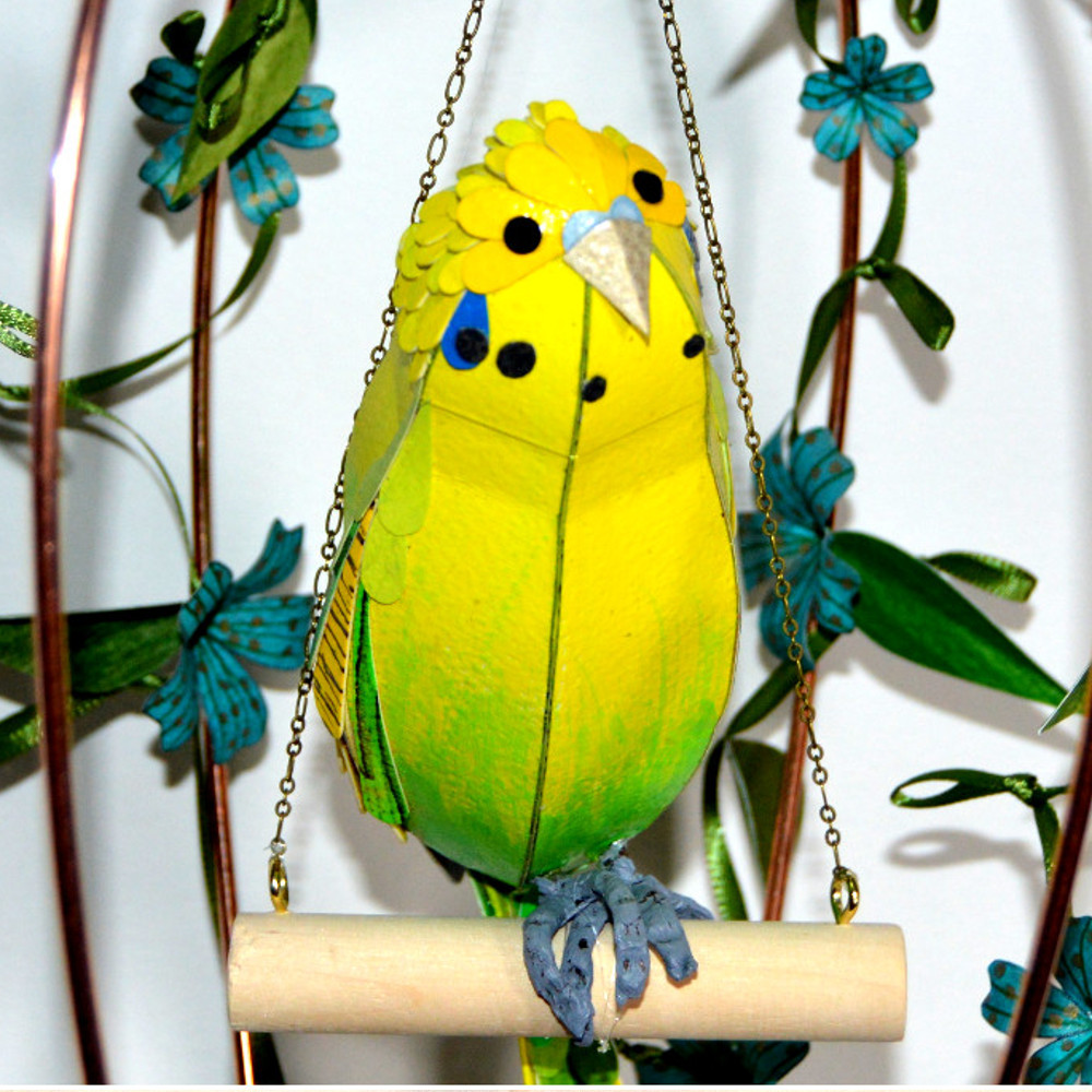 Budgies measure approximately 25 x 6 x 7 cm.  Budgie on a floral swing: £110  Budgie in a floral bird cage: £150