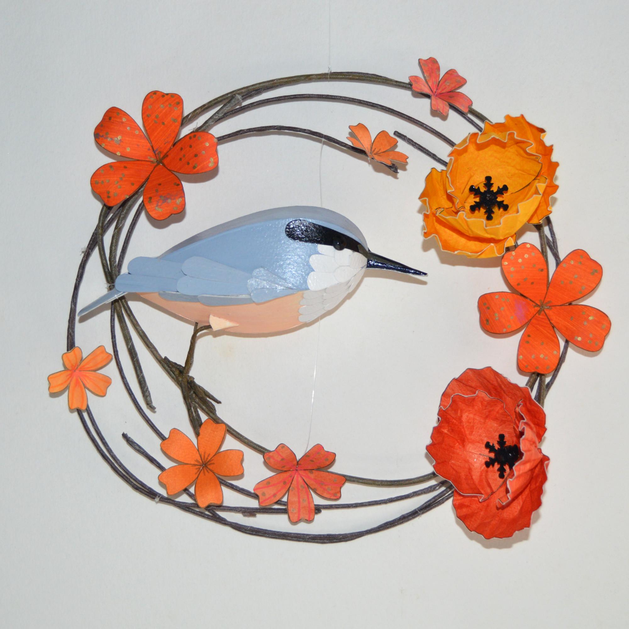 Stevie the nuthatch on a hoop of orange flowers