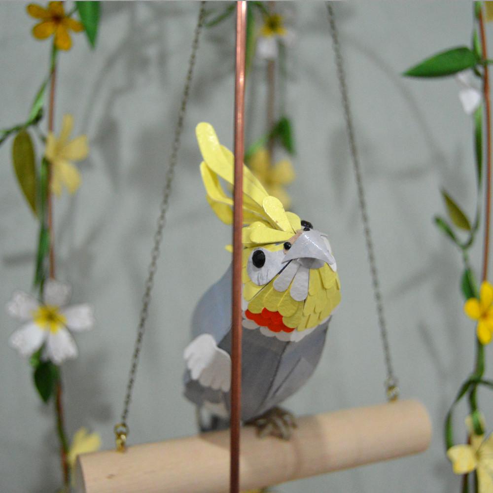 Gunnar the cockatiel, in his bird cage