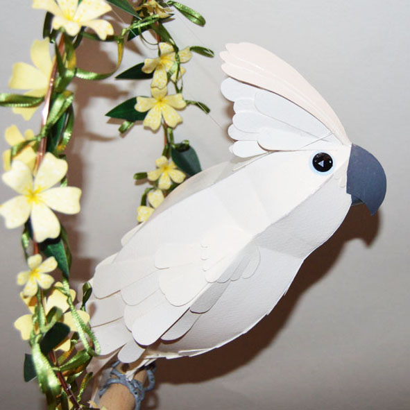 Mortimer the Umbrella Cockatoo, on a yellow floral swing