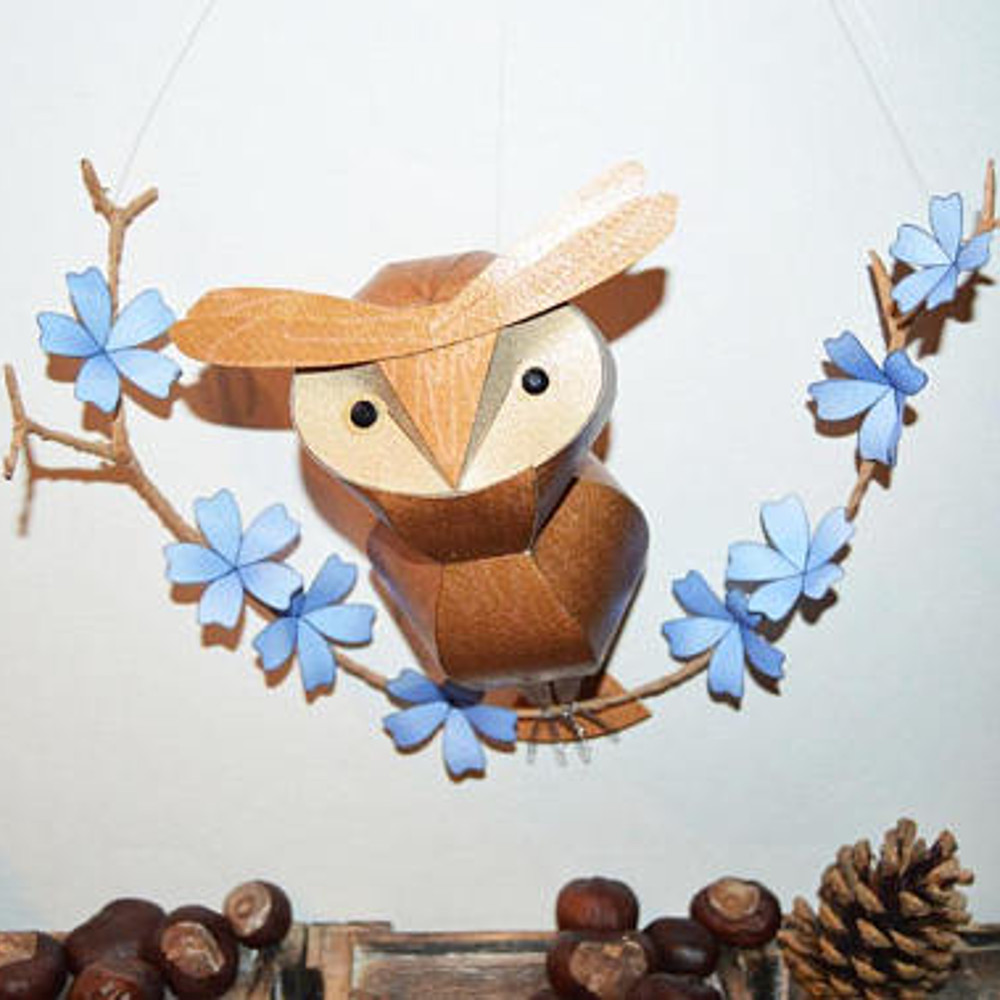 Sanzio the hoot owl, on his branch of blue flowers