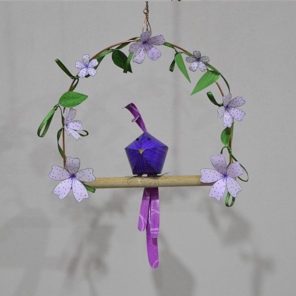 Reggie on a purple floral swing