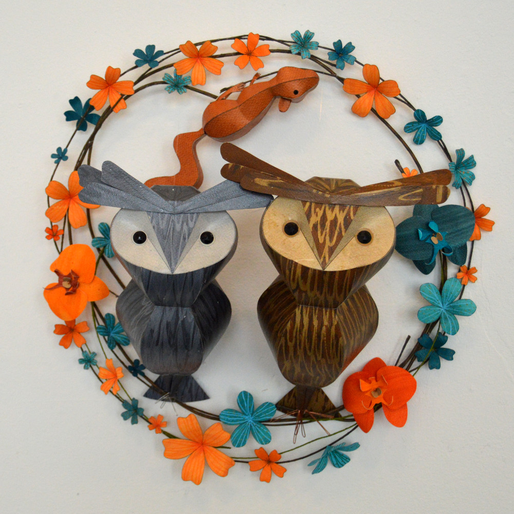 Donnatello & Raphael, with Geronimo the squirrel pup, on a wreath of orange and teal flowers