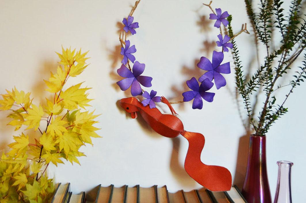 Red squirrel on purple floral branch.jpg