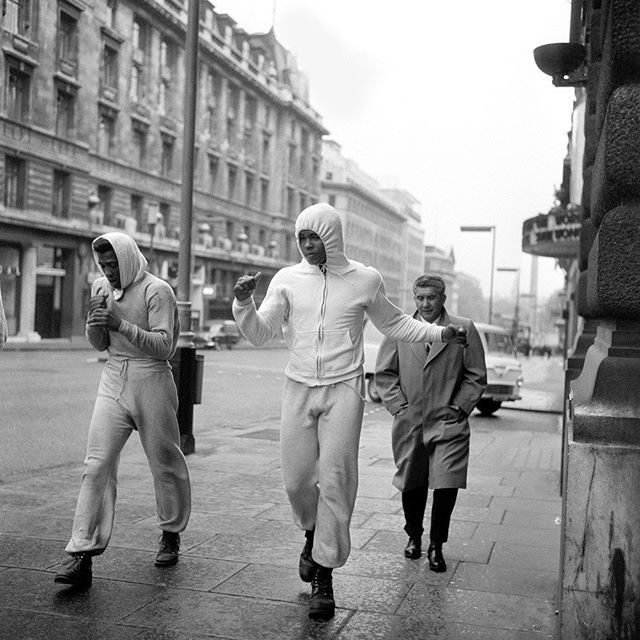 """On this day in 1963, boxing icon Muhammad Ali """"floated like a butterfly"""" past the Hector Powe flagship store on Regent Street.  In preparation for his fight with Henry Cooper at Wembley, Ali's morning training began on the streets of London every day.  #hectorpowe #heritage #archive #muhammadali #otd #ali #london #regentstreet #aliweek #boxing"""