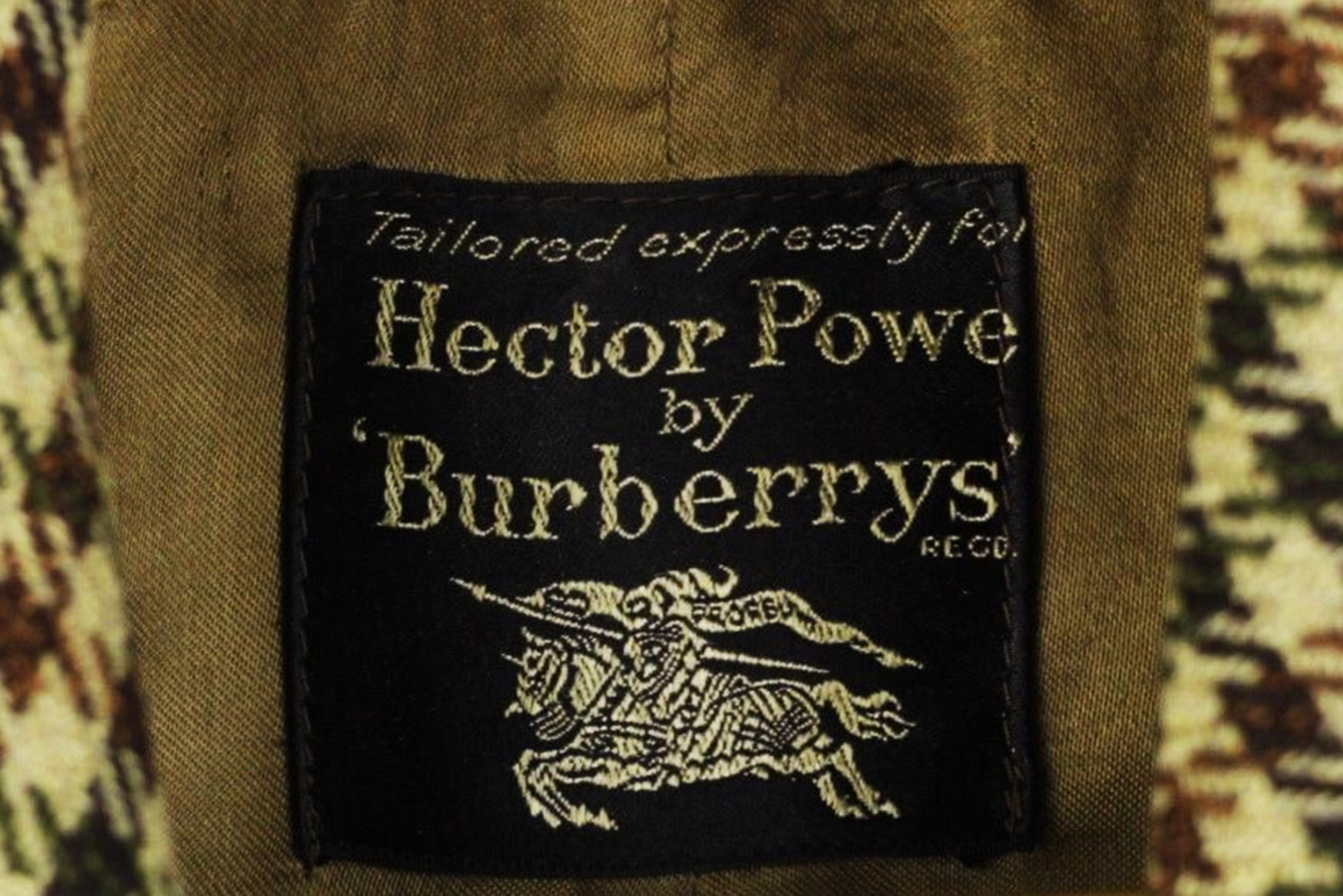 """18 — - """"Hector Powe by Burberrys"""" entered the lexicon of British street subculture, with tribes such as Mod revivalists, second-wave Skinheads, Suedeheads, and even Football Casuals choosing these collaborative pieces as part of their carefully curated uniforms.Hector Powe by Burberrys – Street style uniform"""