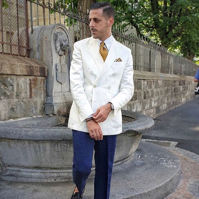 @ygatti combines our Diamond Tie in Dull Gold with a white double-breasted jacket, for an elegant Summer look.  #hectorpowe #heritage #silk #gold #diamond #tie #menswear #summer